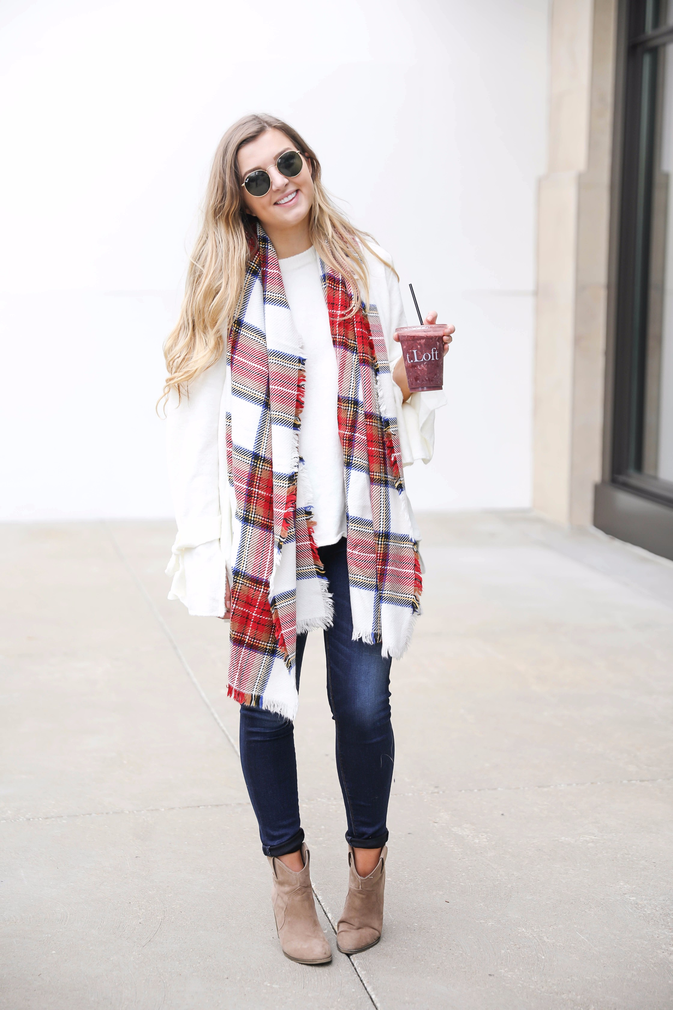 Tied bow sleeve sweater with a plaid blanket scarf! I love blanket scarves for fall. This outfit is perfect with dark jeans and booties! Details on fashion blog daily dose of charm by lauren lindmark