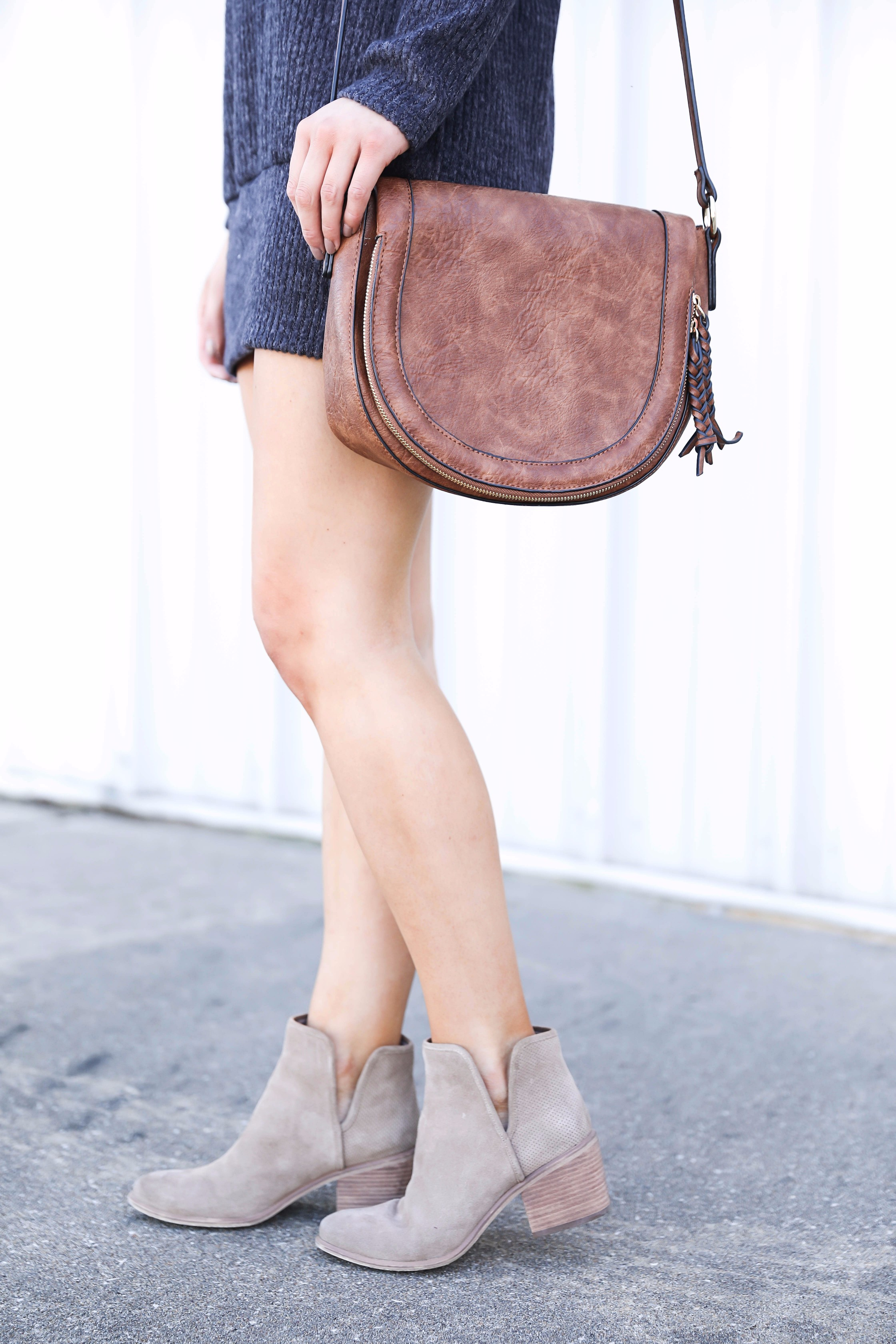 Saddle bag and booties! Off the shoulder sweater dress from BooHoo! Seriously the softest sweater ever! Get the details on fashion blog daily dose of charm by lauren lindmark