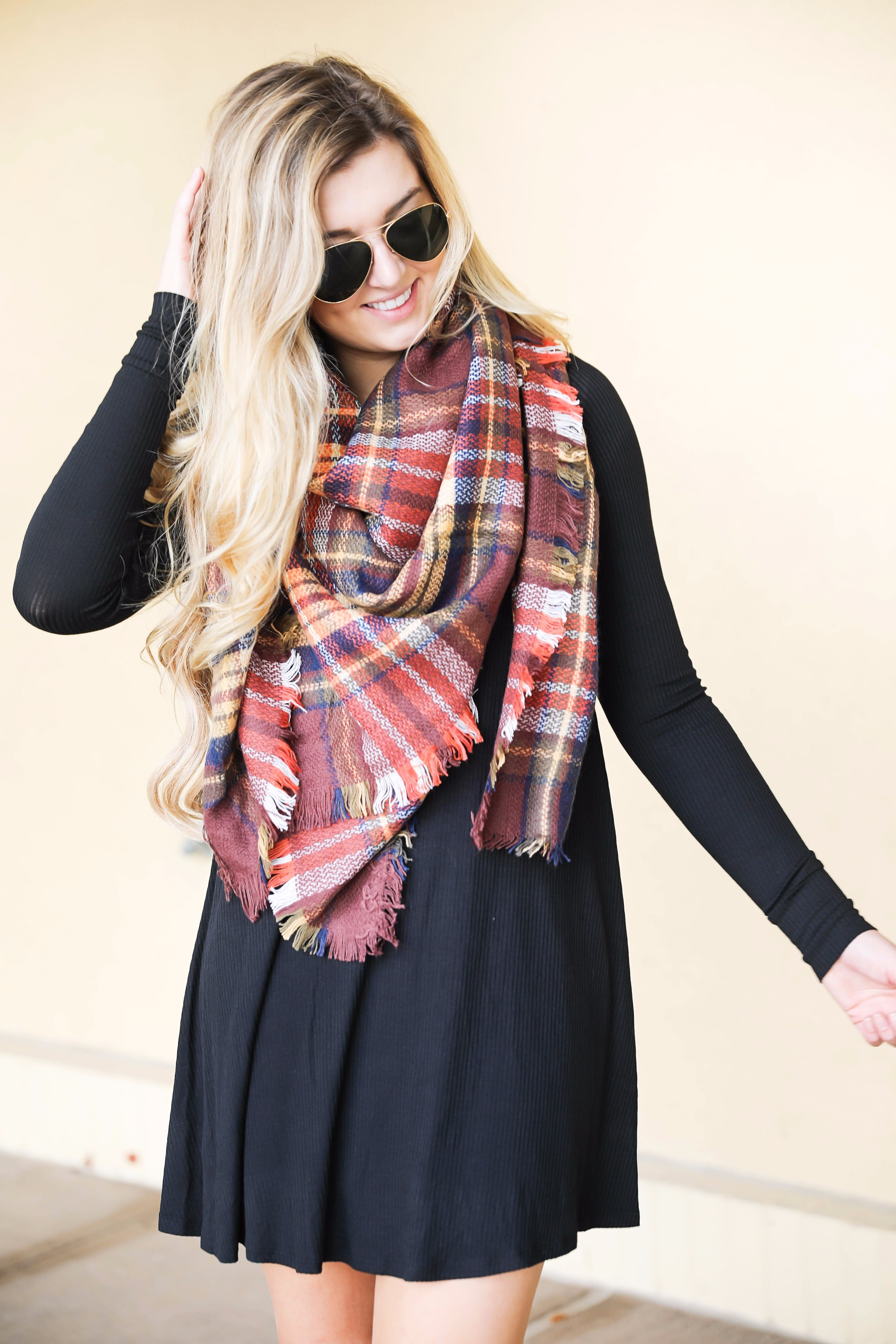 Plaid blanket scarf by ILY Mix paired with a cute black long sleeve dress and booties on fashion blog daily dose of charm