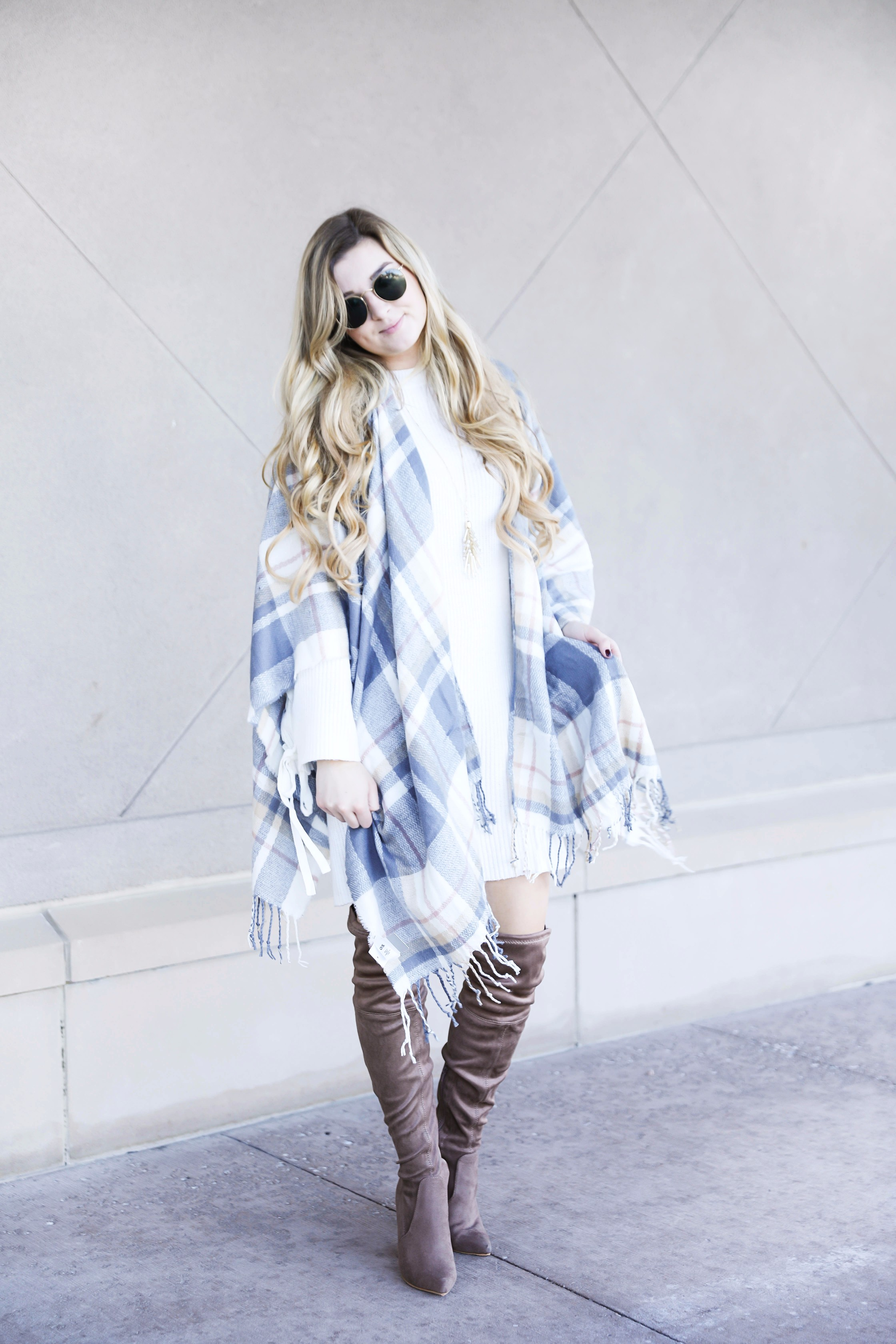 Plaid poncho and cute white sweater dress with tied sleeves! Cutest fall outfit! Check out the details on fashion blog daily dose of charm by lauren lindmark