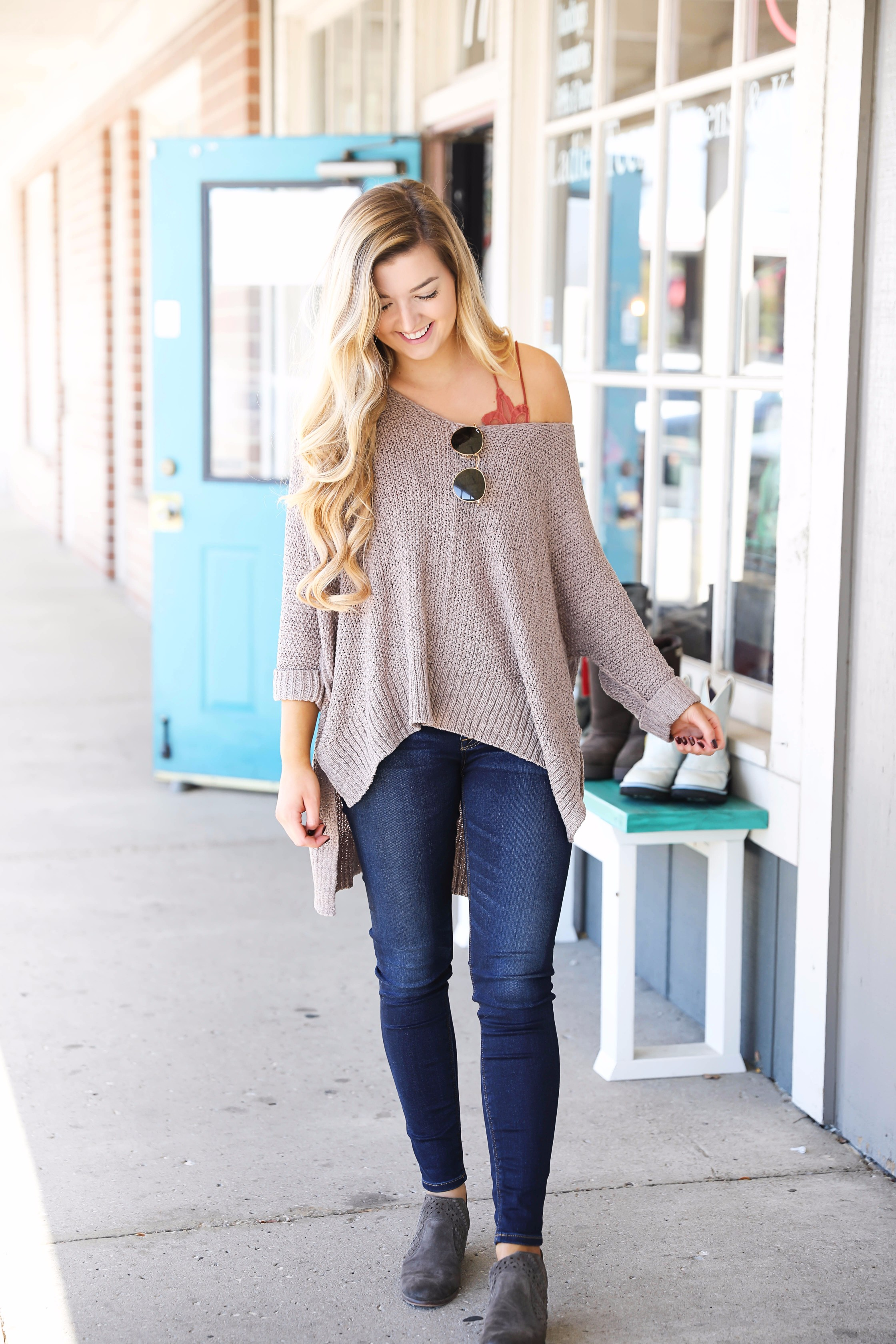 Slouchy off the shoulder sweater with a lace free people bralette! Super cute fall outfit for casual days or can be dressed up! Check out the details on fashion blog daily dose of charm by lauren lindmark