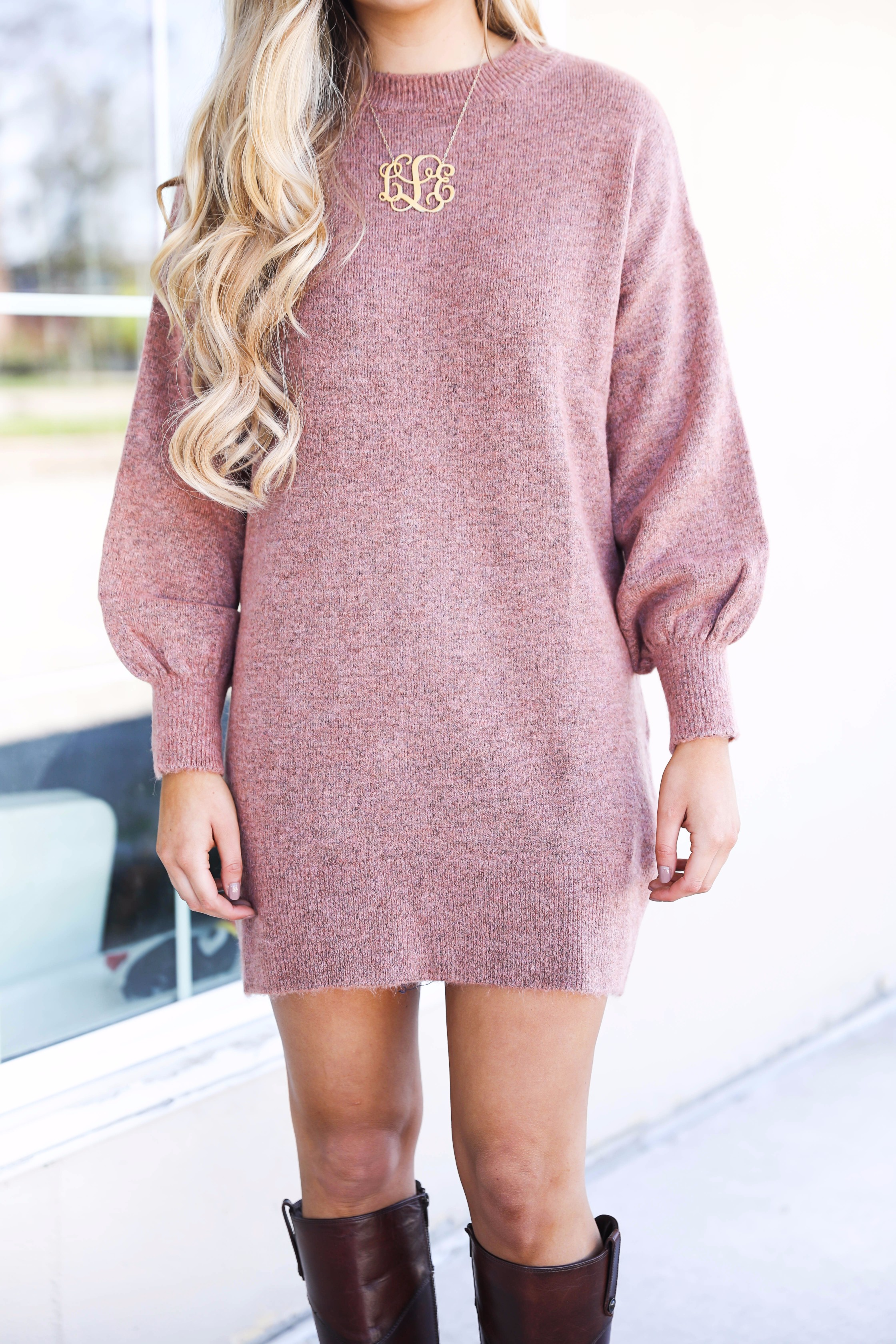Sweater dress with puffy sleeves and brown riding boots! Paired with a large monogram necklace, perfect fall outfit! Details on fashion blog daily dose of charm by lauren lindmark