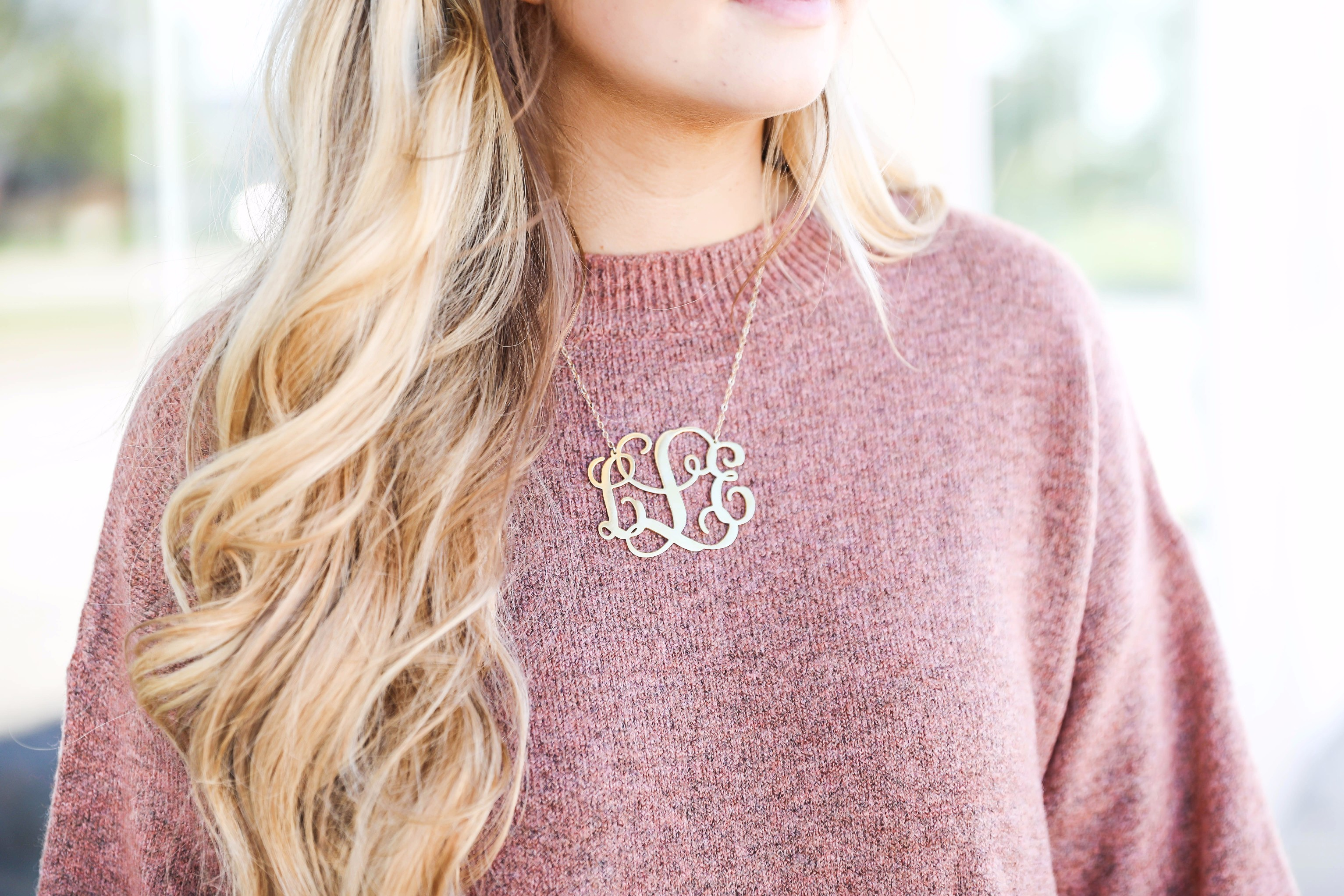 5d2852739167 Paired with a large monogram necklace Sweater dress with puffy sleeves and brown  riding boots! Paired with a large monogram necklace ...