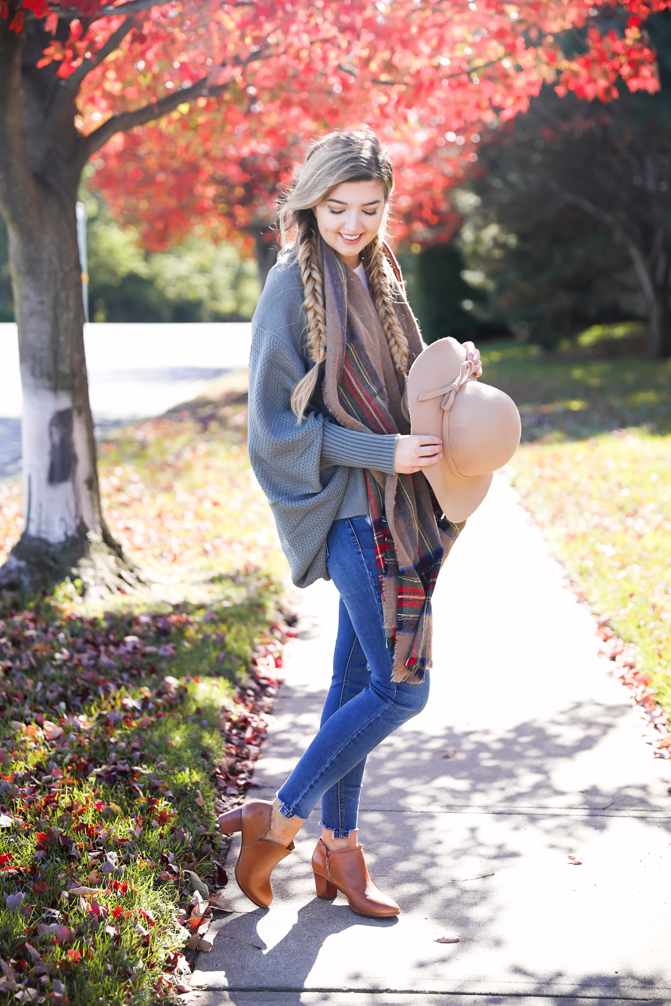 The perfect fall outfit with pretty fall leaves! Slouchy cardigan and plaid blanket scarf on fashion blog daily dose of charm by lauren lindmark
