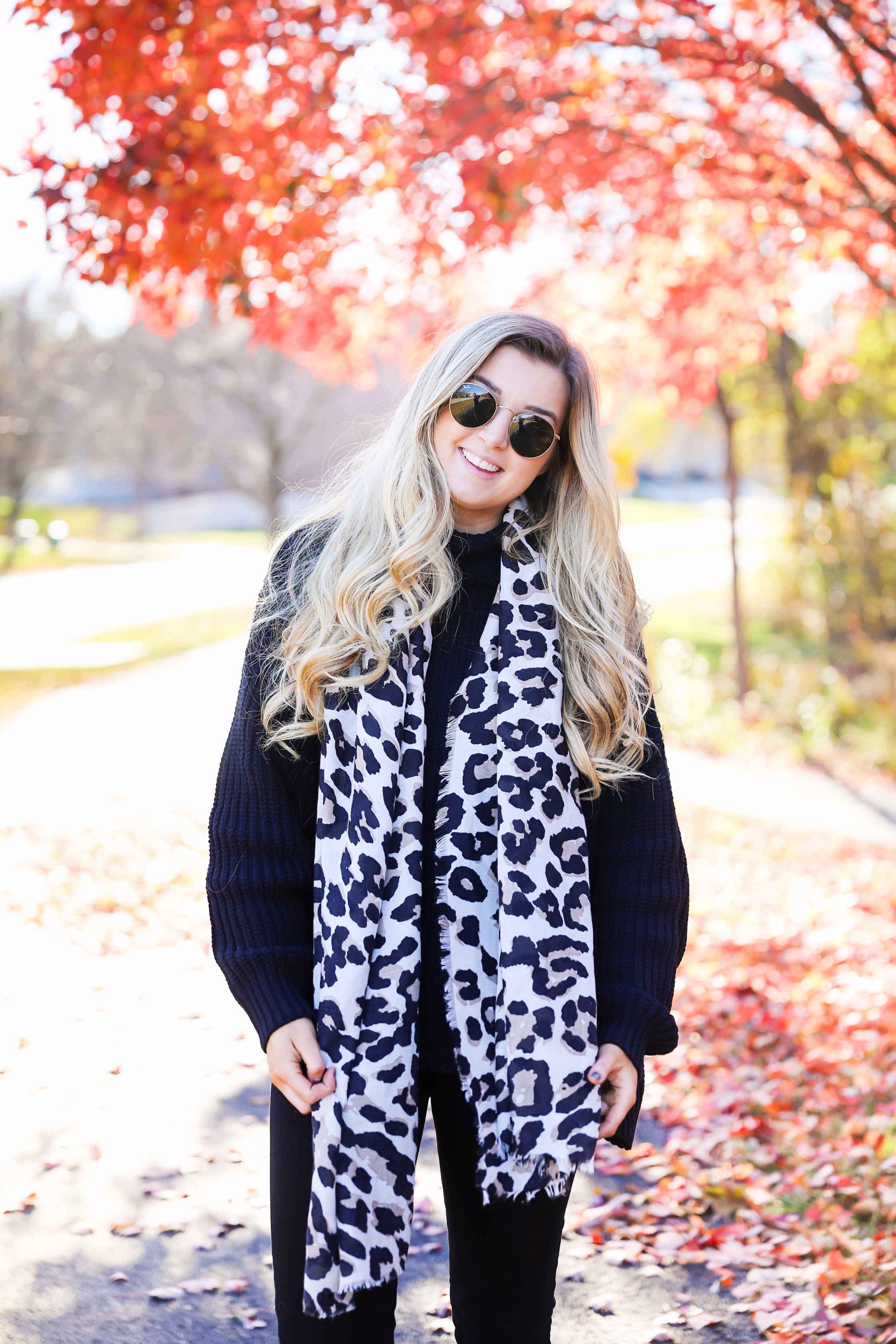All black outfit with leopard scarf! Cute black sweater and black jeans with black booties! Plus a roundup of black friday and cyber monday sale deals on fashion blog daily dose of charm by lauren lindmark