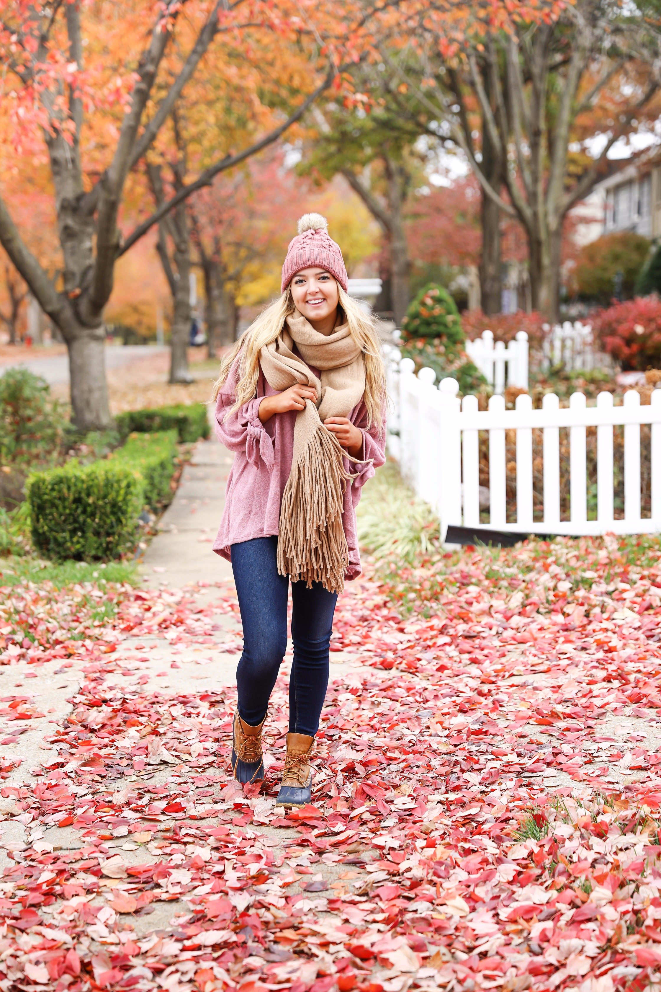 Big fringe scarf with pink tied sweater and pink beanie! Perfect girly fall outfit! Find details on fashion blog daily dose of charm by lauren lindmark