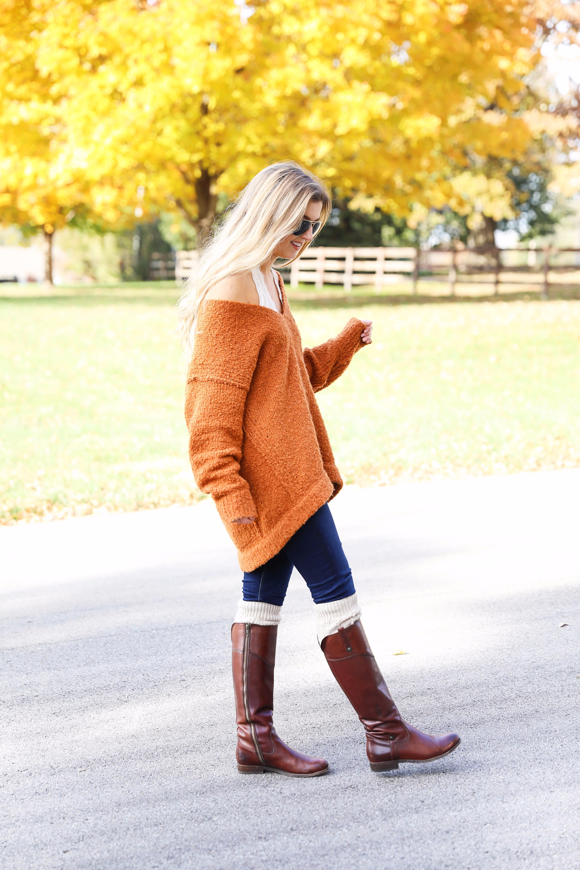 Burnt orange soft free people sweater paired with frye boots and cable knit socks. Fall fashion inspiration! Get details on daily dose of charm fashion blog lauren lindmark