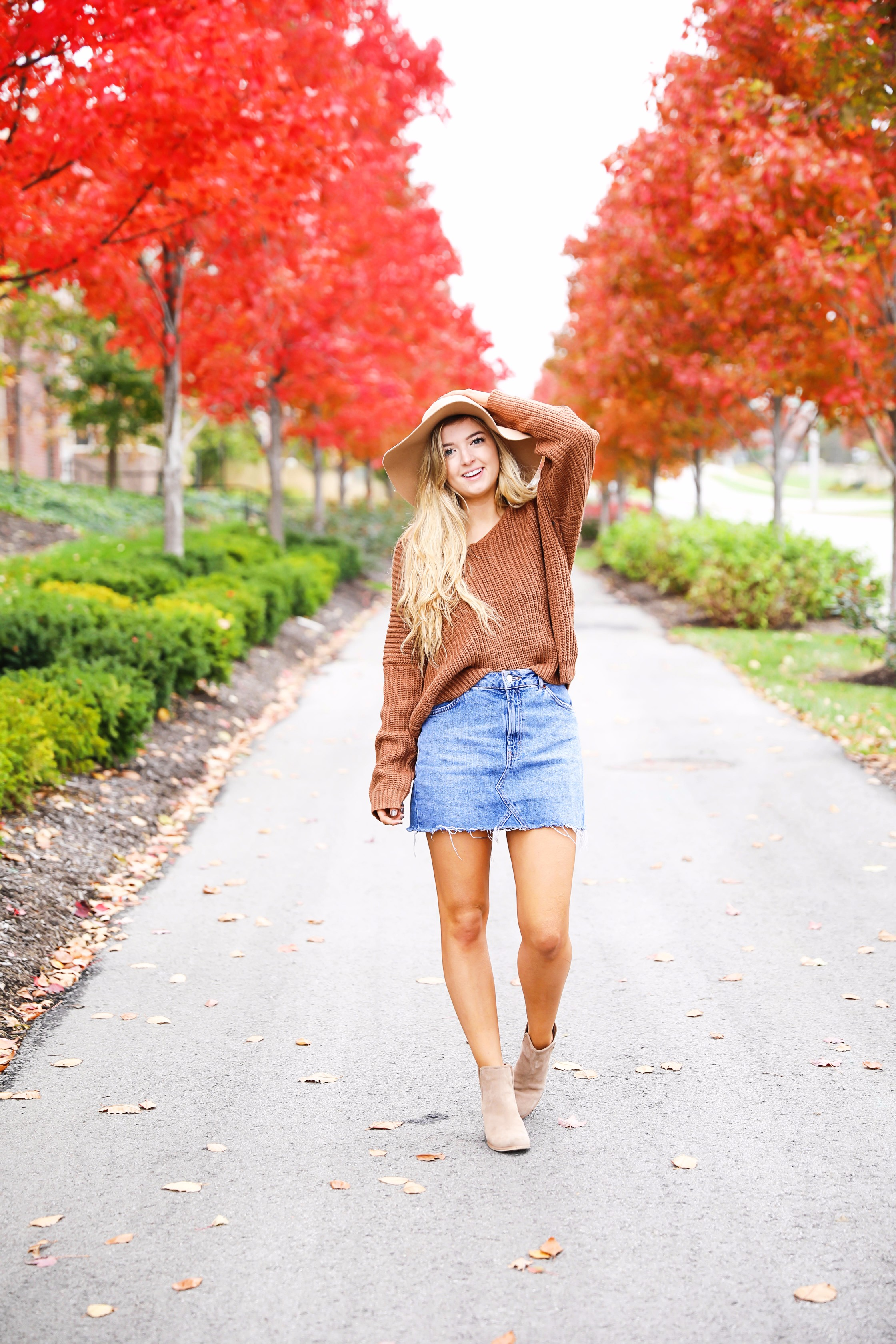 Burnt orange sweater that is crisscrossed tied in the back! Perfect for fall paired with jeanskirt and floppy felt hat. Fall and thanksgiving outfit ideas! Details on fashion blog daily dose of charm by lauren lindmark