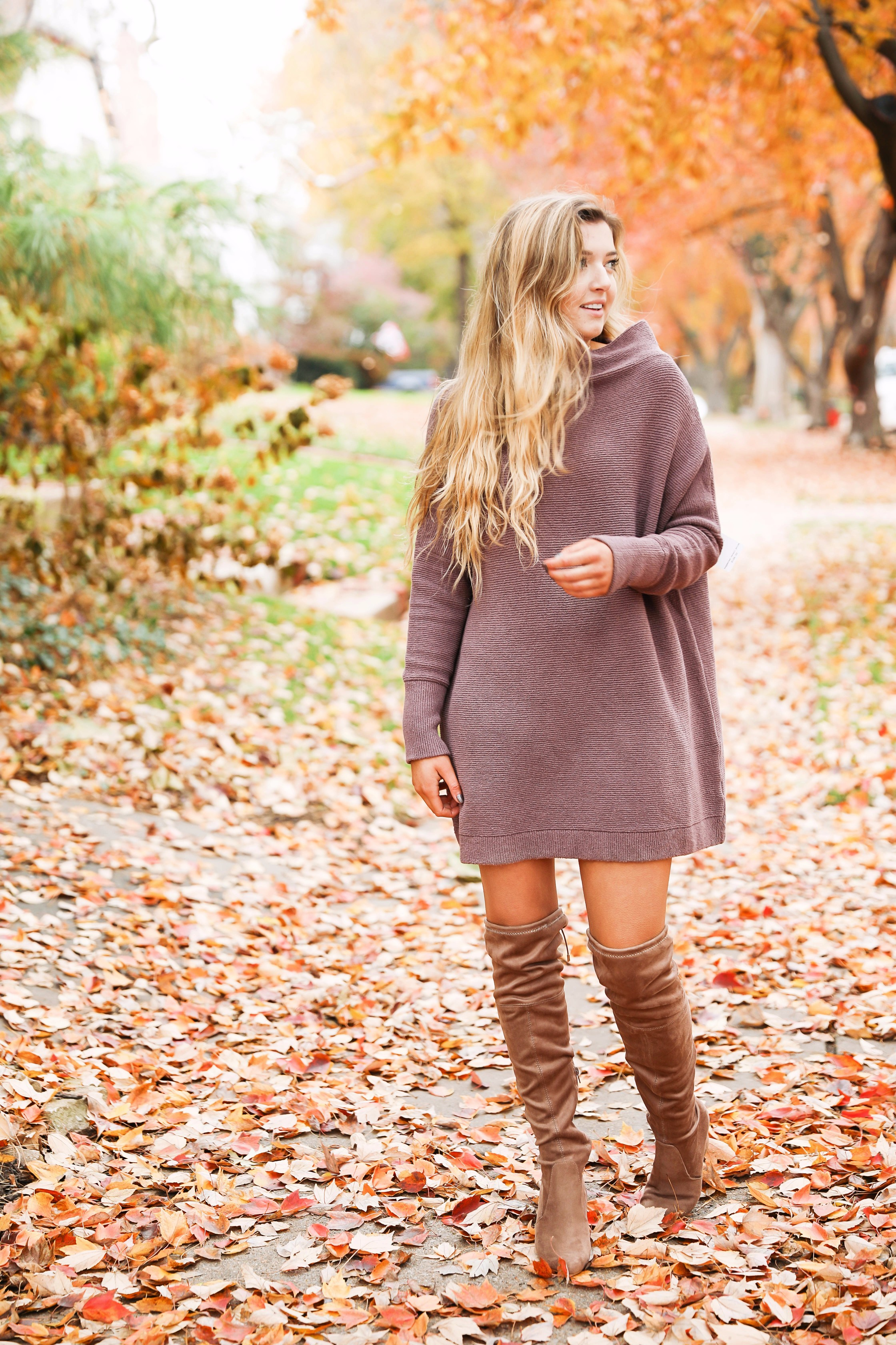 Purple free people Ottoman Slouchy Tunics weater dress! This cute fall look is perfect paired with brown suede over the knee boots! Find the details on fashion blog daily dose of charm by lauren lindmark