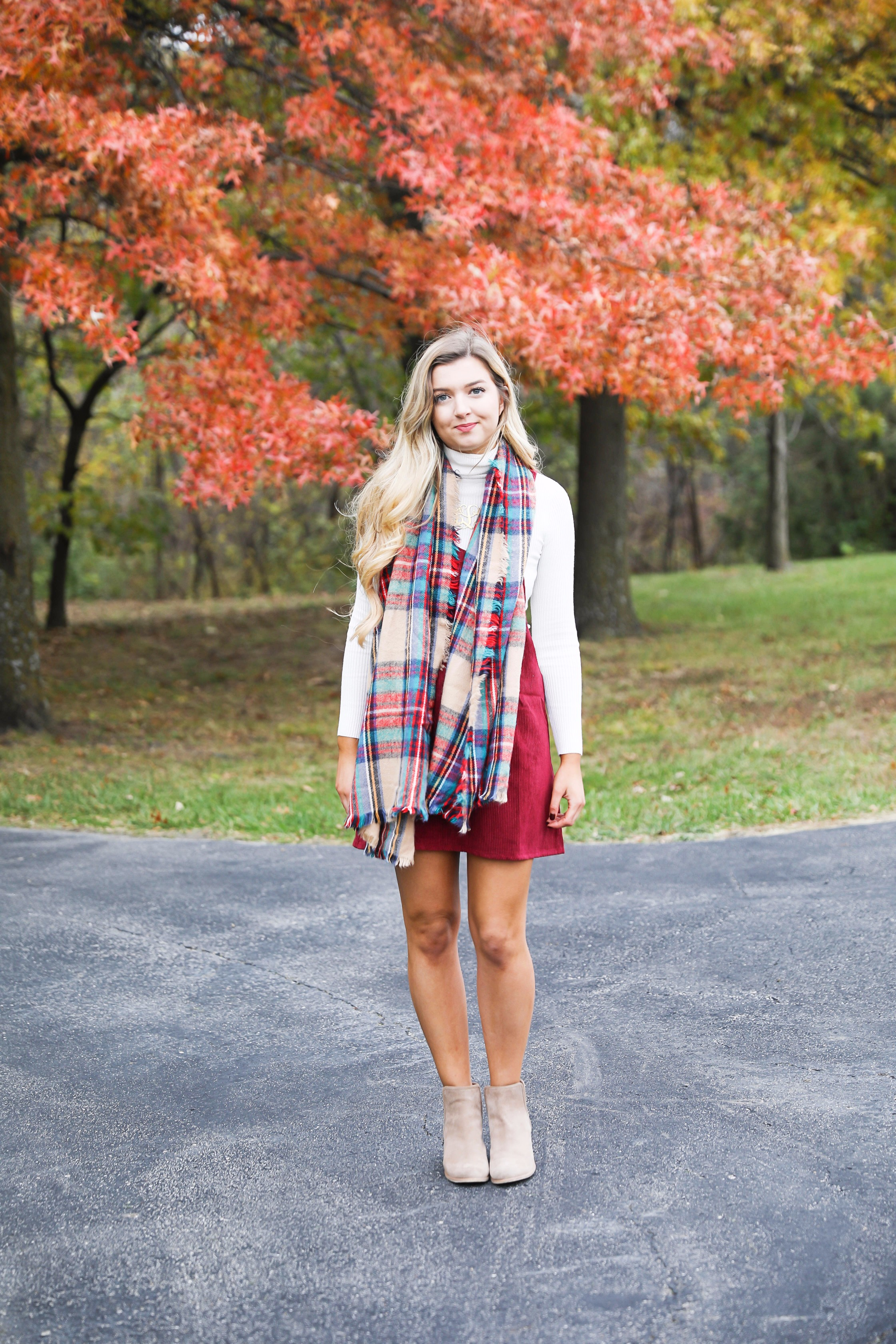 Red corduroy overall dress with white turtleneck and blanket scarf! The cutest fall outfit for a fall trees and foliage photoshoot! Get details on fashion blog daily dose of charm lauren lindmark
