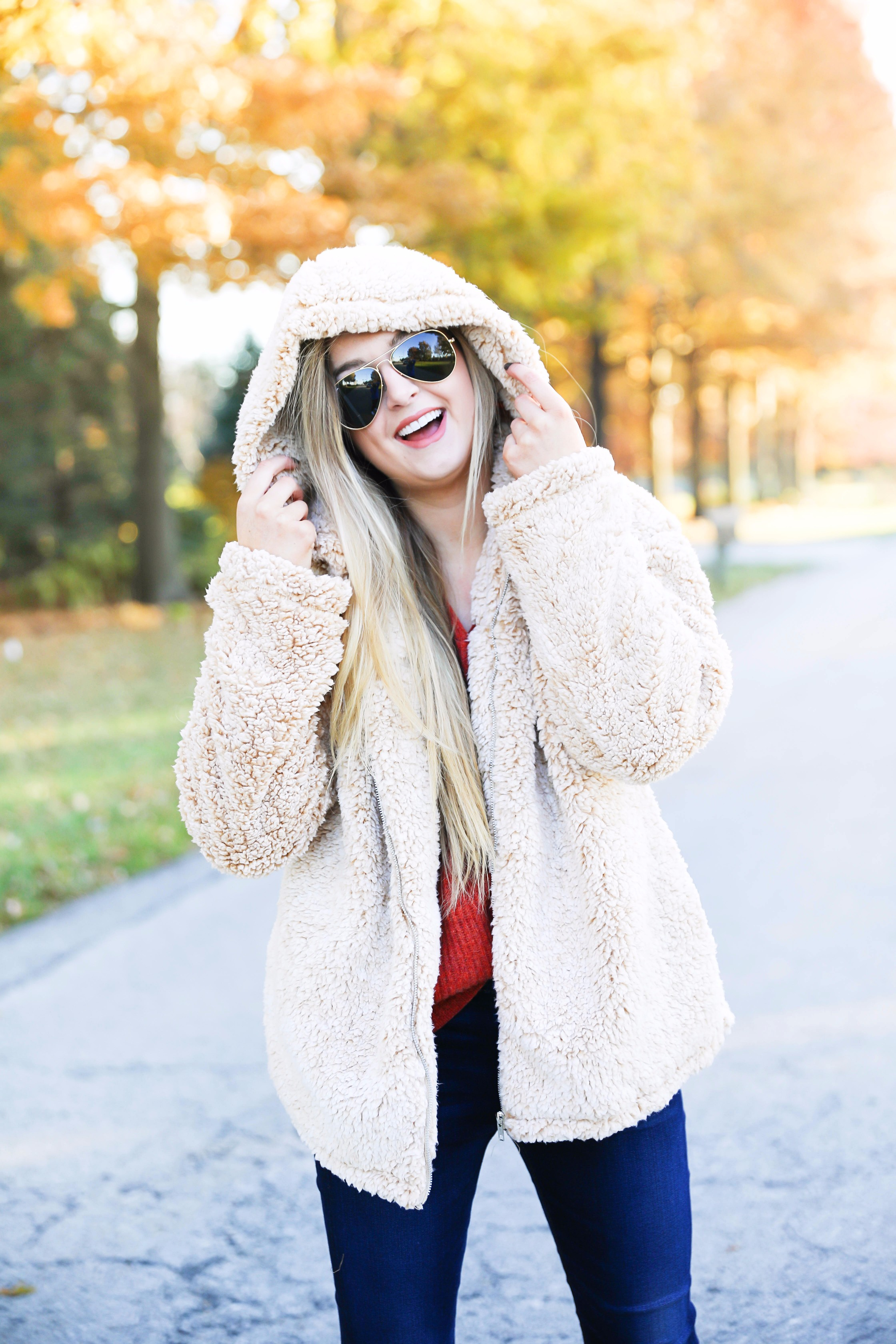 Red sweater and teddy bear coat! This adorable fall outfit is so cozy and the teddy bear coat is so inexpensive! Find the details on fashion blog daily dose of charm by lauren lindmark