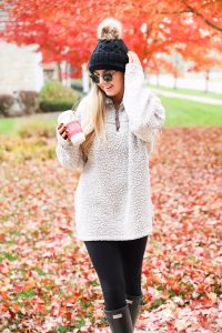True grit sweatshirt with faux fur black beanie! Cute and comfy fall fashion! Find the details on daily dose of charm lauren lindmark