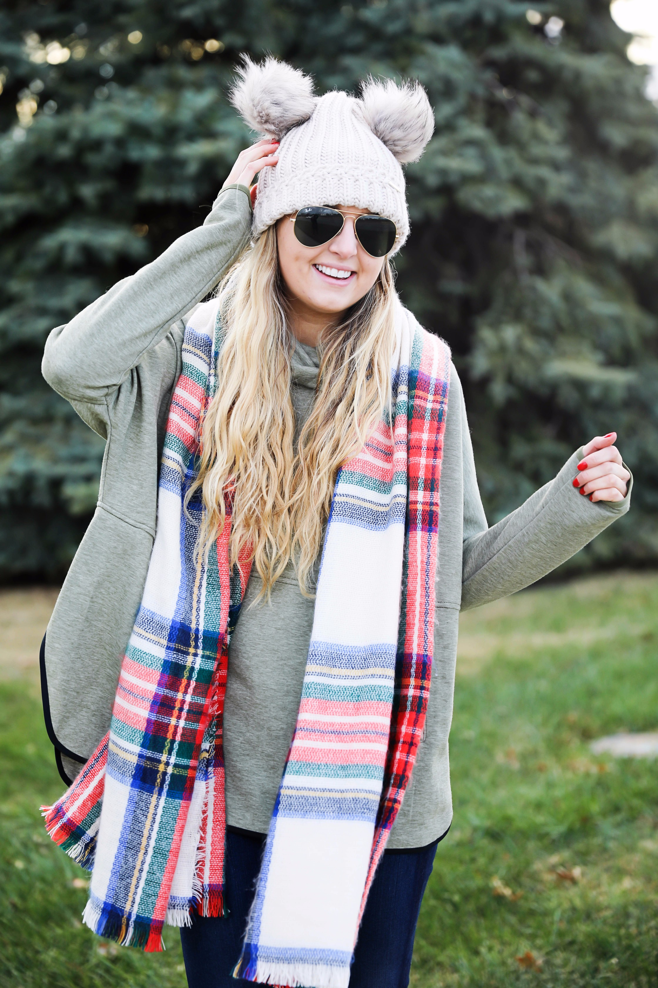 Christmas colored plaid scarf paired with my olive north face and faux fur ear beanie! Wearing my green hunter boots to make this look a casual holiday outfit! Details on daily dose of charm by lauren lindmark