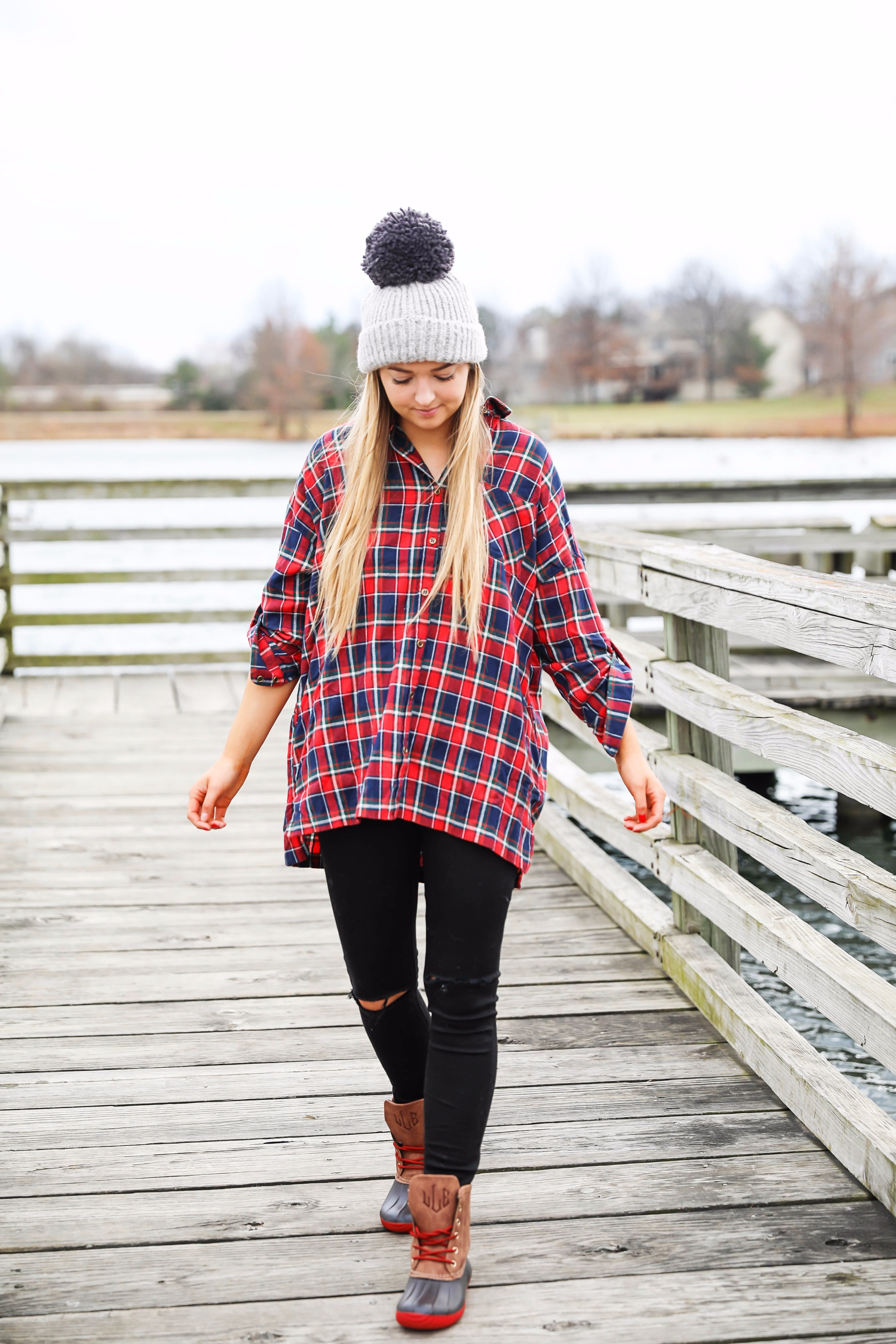 Cute flannel outfit with beanie and monogramed duck boots! Cute fall and winter camping outfit idea! Details on the fashion blog daily dose of charm by lauren lindmark