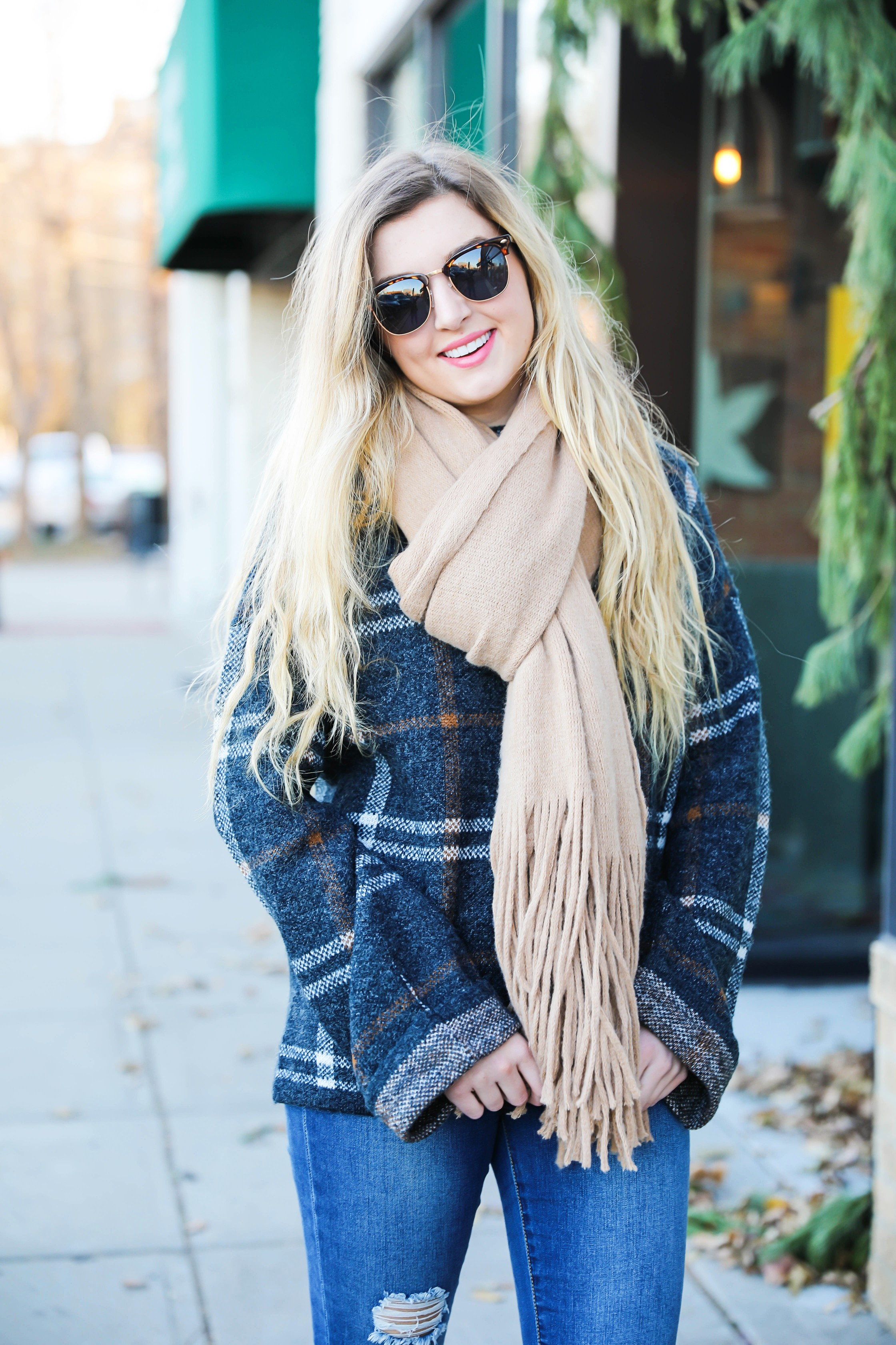 Plaid sweater with fringe free people scarf! Super cute winter outfit idea! Get all the details on fashion blog daily dose of charm by Lauren Lindmark