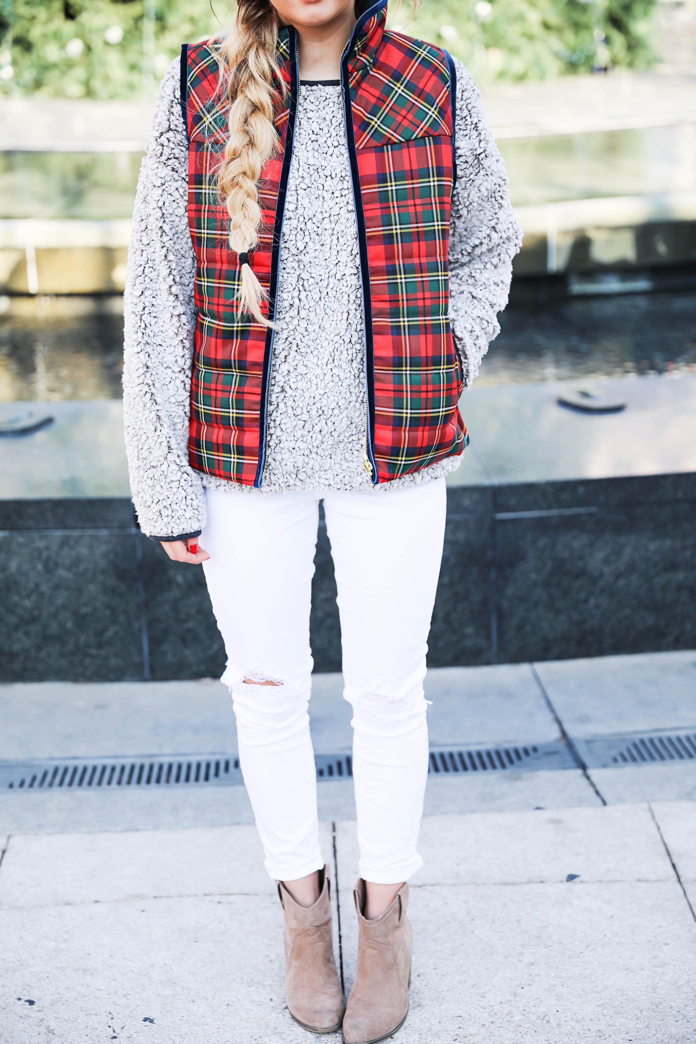 Tartan plaid j.crew vest with Dylan true grit comfy crewneck sweatshirt with white ripped jeans and side braid with long hair. Find the details for this winter outfit on fashion blog daily dose of charm by lauren Lindmark