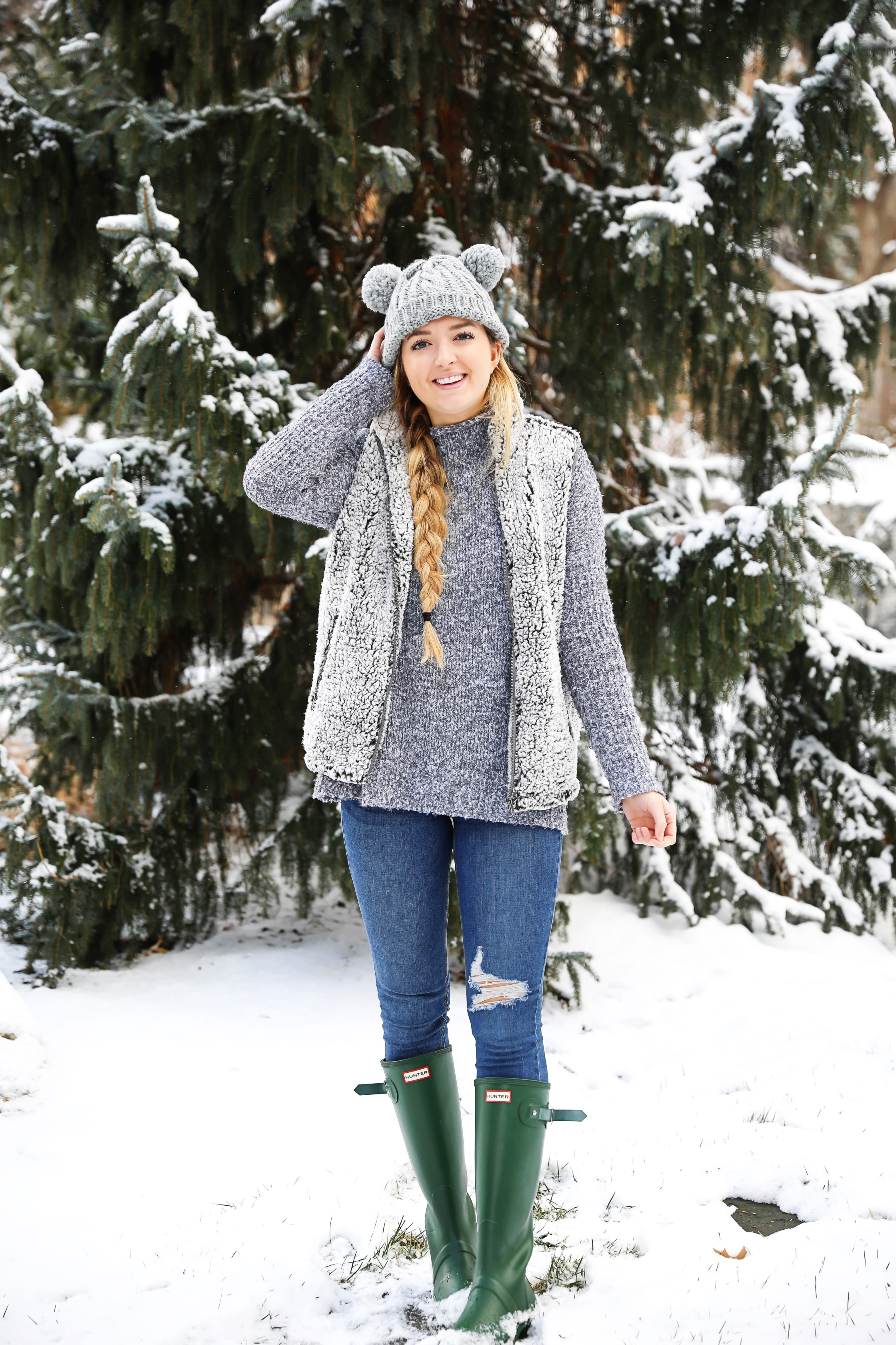 This sherpa vest is the coziest thing I own! I paired it with this soft grey sweater that has a cute turtleneck. I am also wearing my grey pom pom beanie! It has two pom poms which is super cute! I love this winter outfit! Details on fashion blog daily dose of charm by lauren lindmark