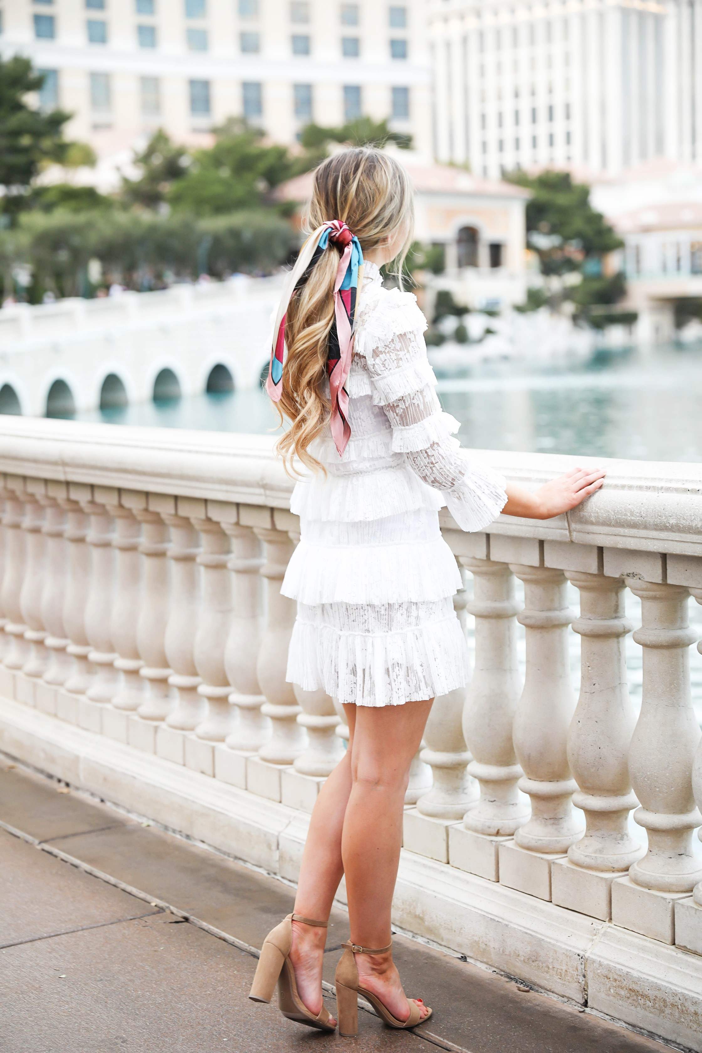 Bellagio fountains in Las Vegas! Wearing a white lace dress and scarf in my pony tail! Las Vegas style! Las vegas blogger! Details on daily dose of charm by lauren lindmark