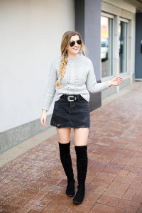 Edgy meets cozy! Adorable ripped black denim skirt with over the knee black boots! Paired with a cozy grey J.Crew cable knit sweater! Details on fashion blog daily dose of charm by lauren lindmark