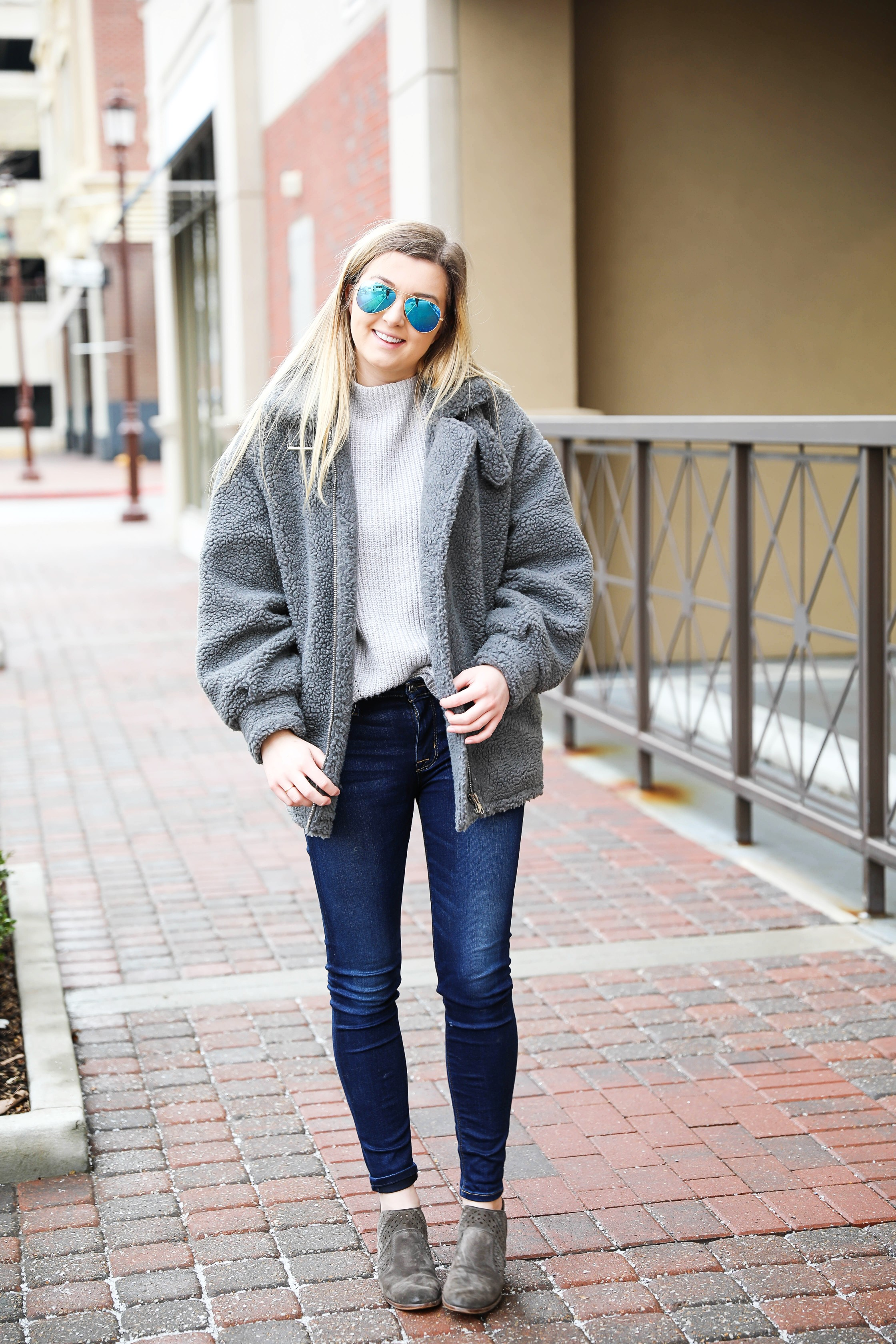 Fuzzy grey aviator coat! Paired this soft jacket with my favorite ray ban blue mirrored aviators! Details on fashion blog daily dose of charm by lauren lindmark