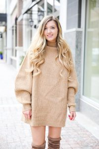 Tan sweater dress from h&m with puffy sleeves. Paired with tan over the knee heeled boots! I love otk boots for winter and spring. Details on fashion blog daily dose of charm by lauren lindmark