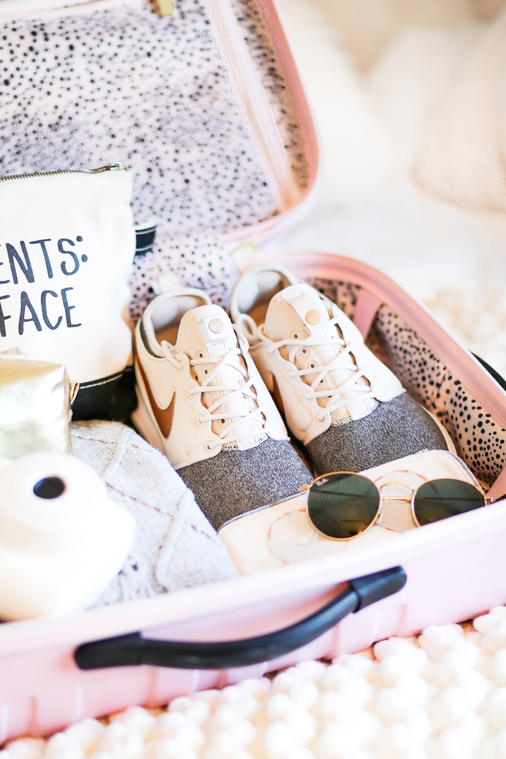 suitcase packing pink suitcase packed suitcase cute suitcase packing tips daily dose of charm lauren lindmark