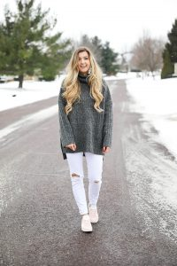 Grey oversized sweater with white jeans and pink sneakers! I paired them with my white earrings and I think it is a perfect outfit to transition into spring! Also a cute Valentine's Day. Details on fashion blog daily dose of charm by lauren lindmark