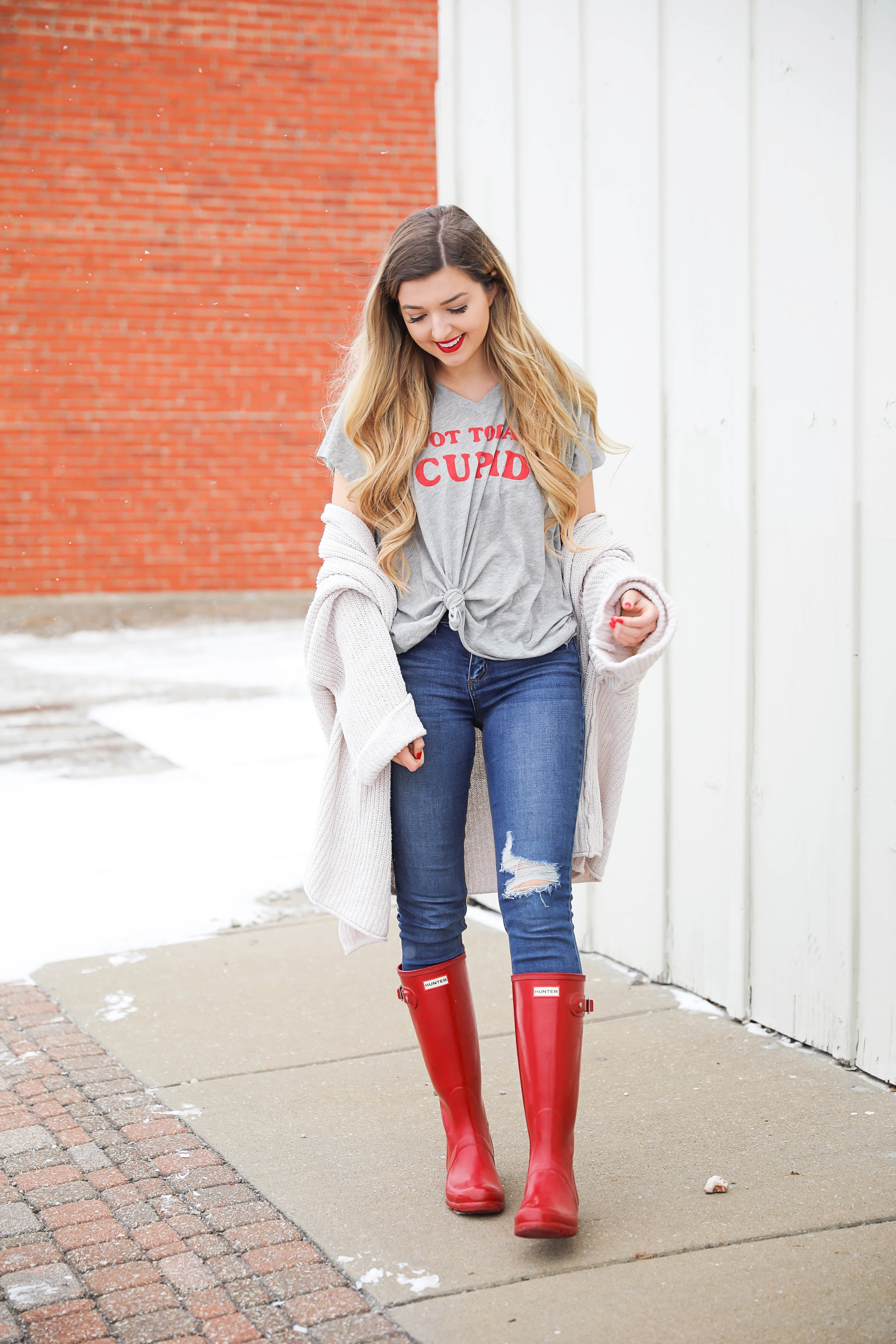 Not today cupid valentine's day tee! Single tee for Valentine's Day. I love this funny valentine's day shirt with free people low tide cardigan over it! I paired it with my red glossy hunter boots! Details on daily dose of charm by lauren lindmark