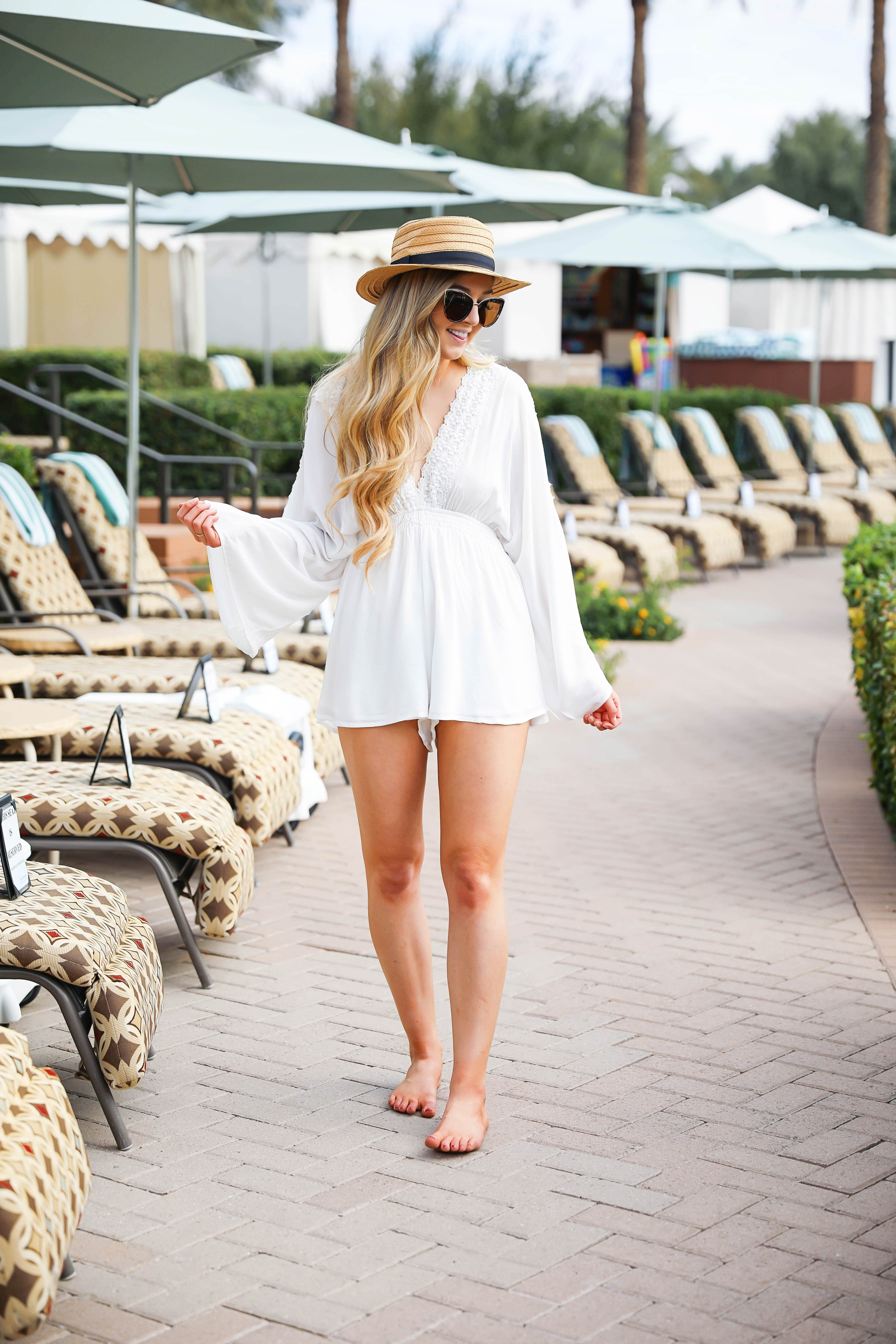 White pool cover up perfect for spring break! This cute white romper from showpo is so cute and so summery and the cutest outfit for the beach! Details on fashion blog daily dose of charm by lauren lindmark