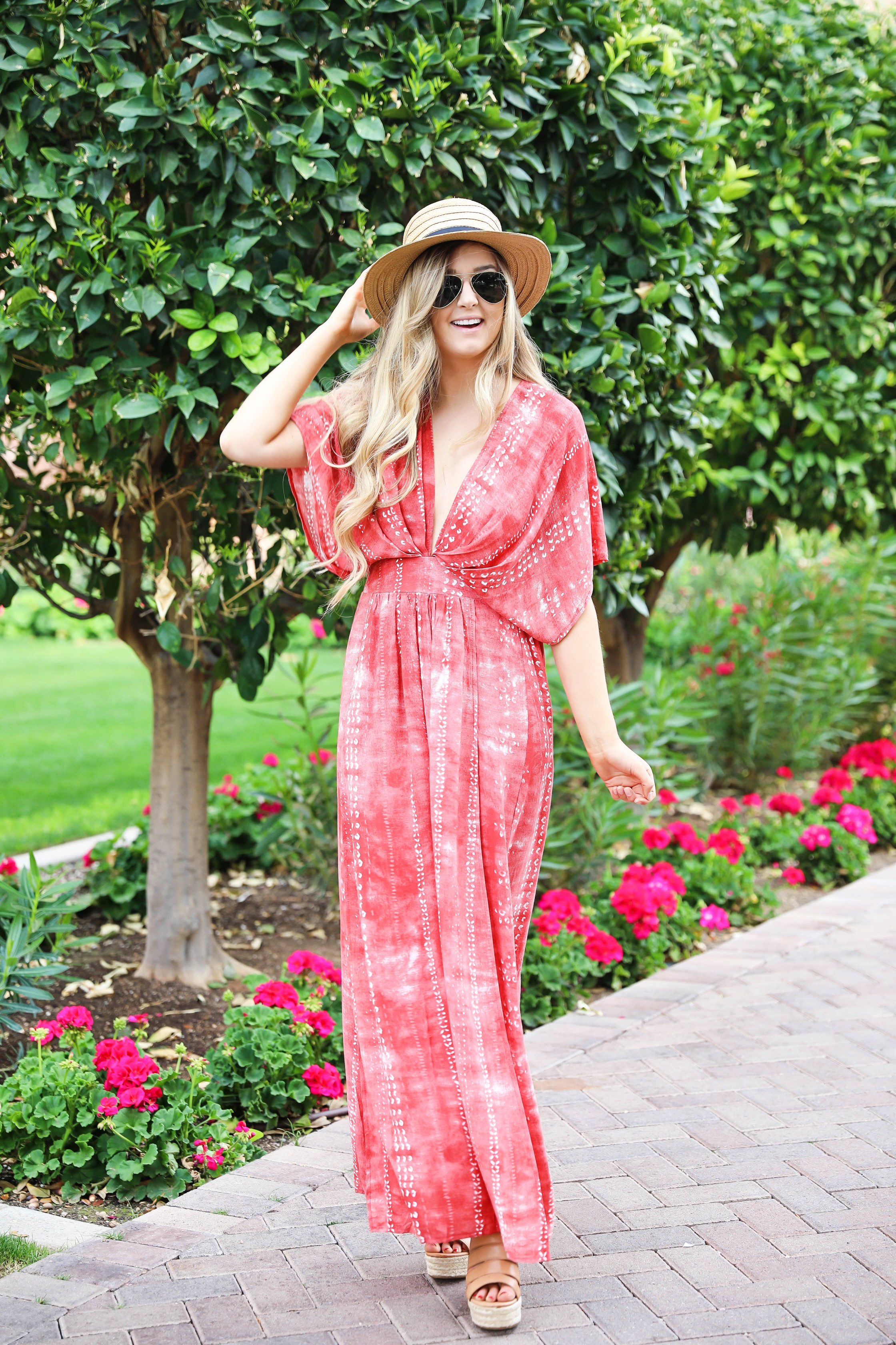 Red tie dye maxi dress from Showpo! Maxi dress with a cute plunging neckline paired with astraw hat and Marc fisher wedges! Details on fashion blog daily dose of charm by lauren lindmark spring break outfit ideas