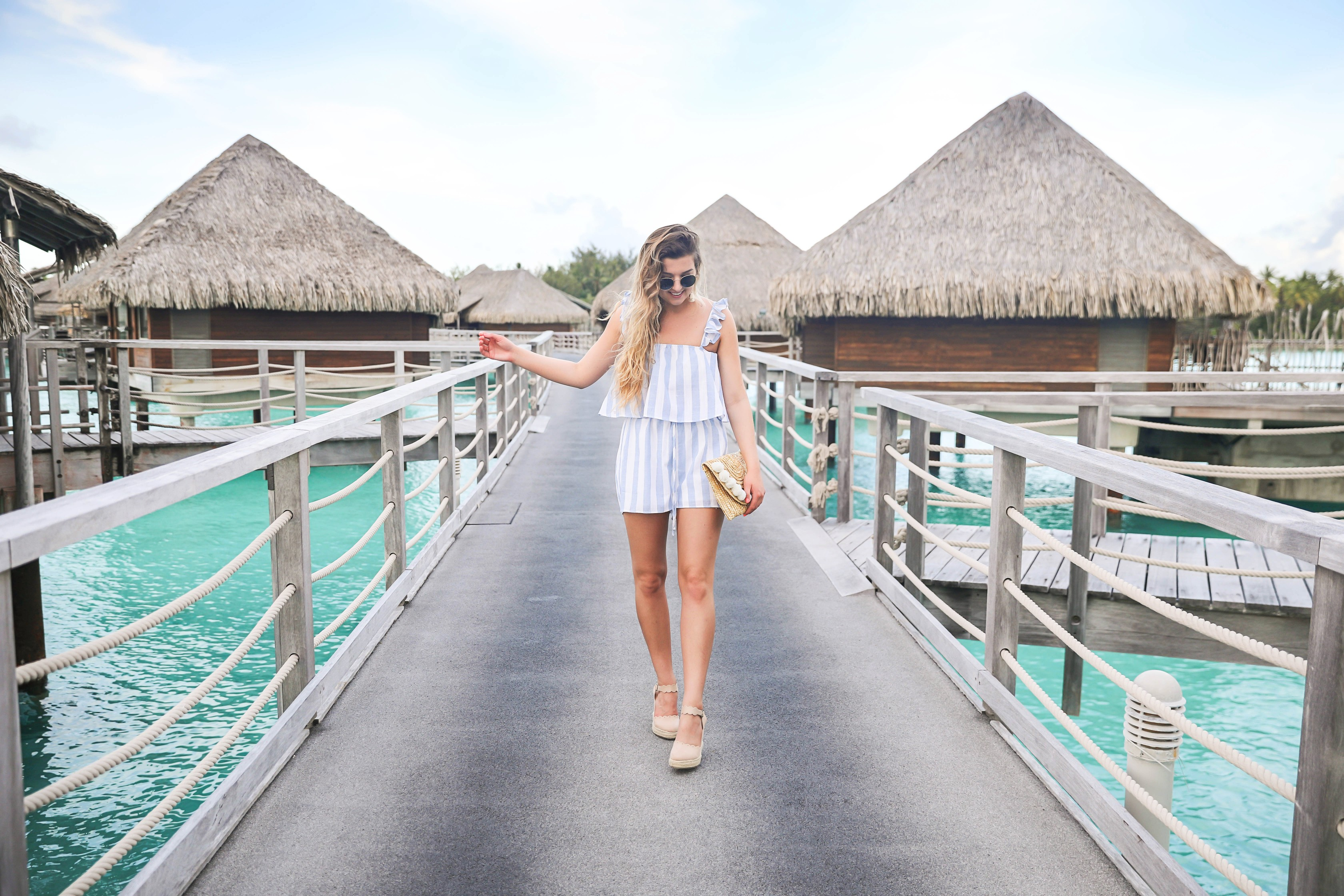 Bora Bora Intercontinental Hotel Thalasso! Trip to Bora Bora on fashion and travel blog Daily Dose of Charm by Lauren Lindmark! The perfect beach outfit! Striped blue and white two piece outfit!