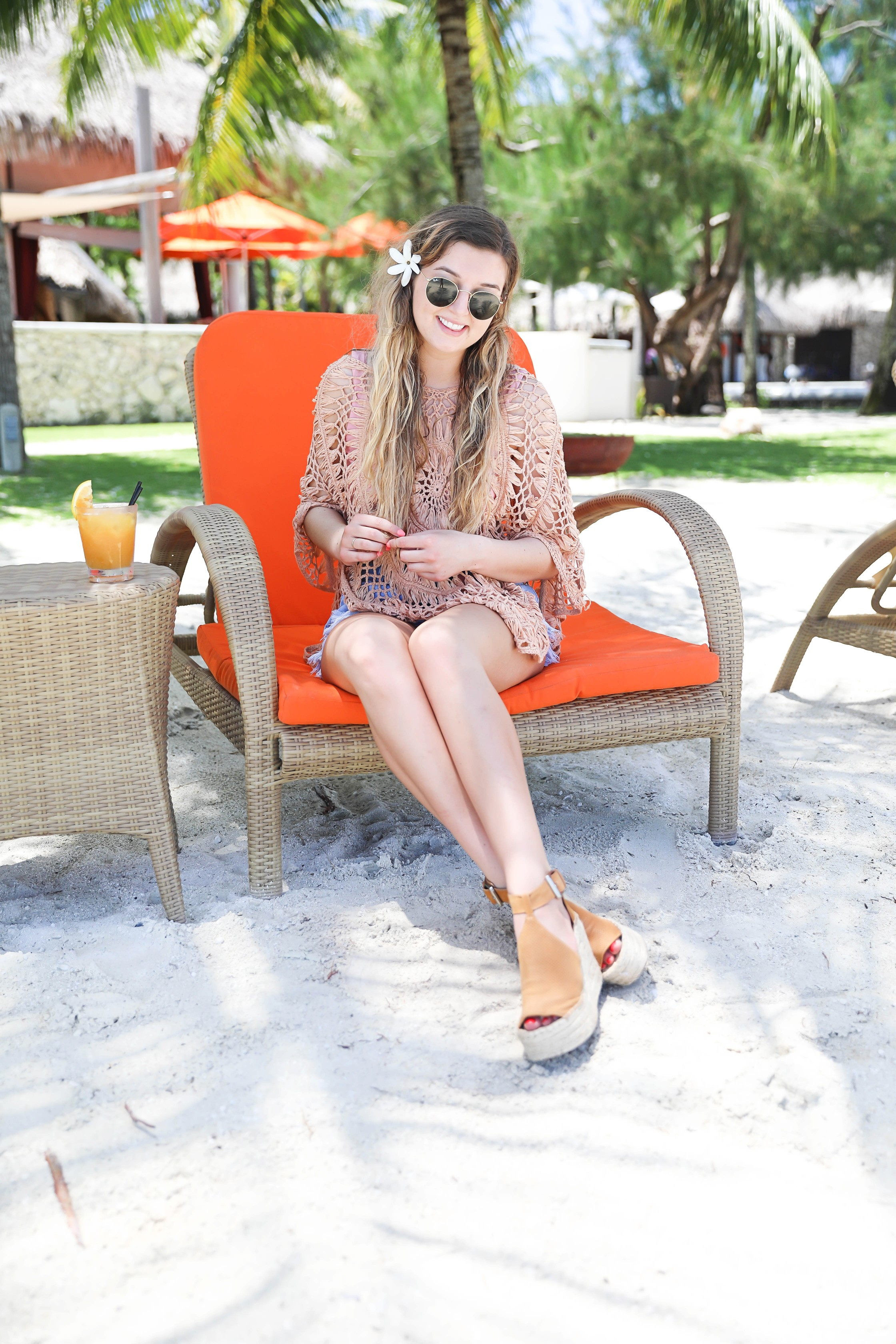 Crochet pool coverup for spring break and summer! Photos on orange pool chair! Bora Bora island vacation photos! Details on fashion blog daily dose of charm by lauren lindmark
