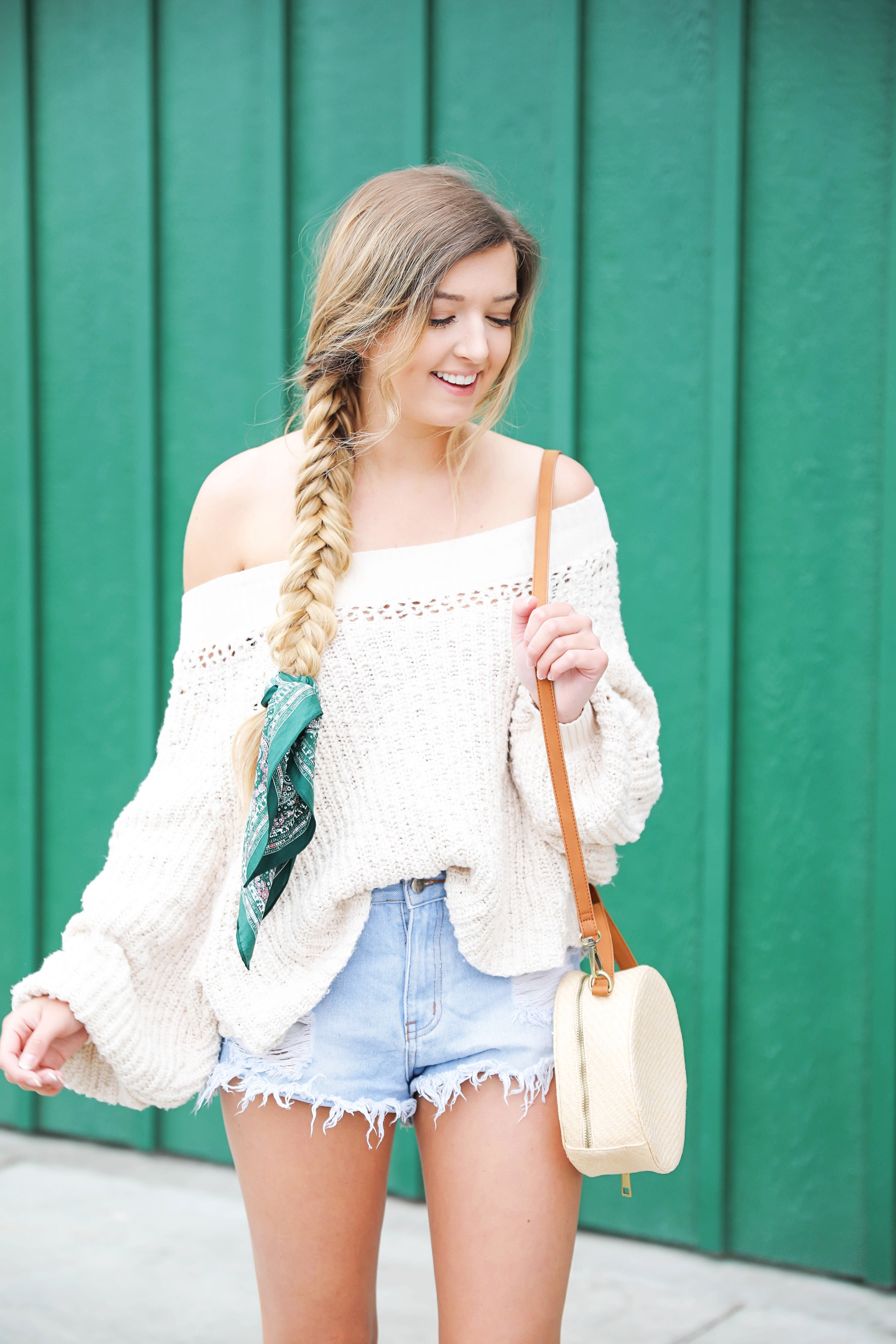 Free People slouchy off the shoulder cream sweater! Paired with light wash ripped denim shorts and a silk hair scarf tied around my fishtail braid! Get details on fashion blog daily dose of charm by lauren lindmark