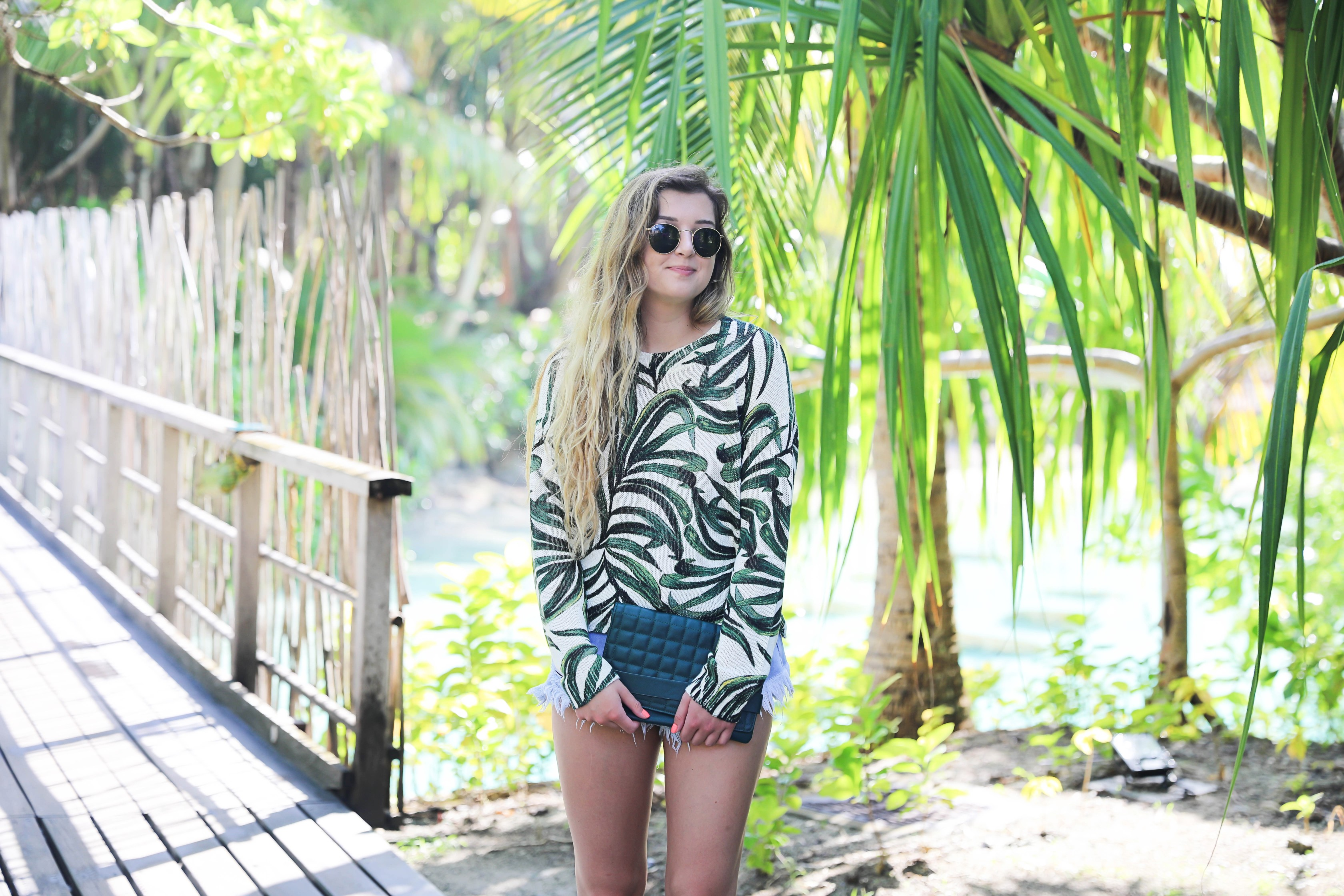 Show me your mumu palm sweater! Paired with cute cut off denim shorts from Showpo! Travel blogger in bora bora, French polynesia! I stayed at the Intercontinental! Details on fashion blog daily dose of charm by lauren lindmark