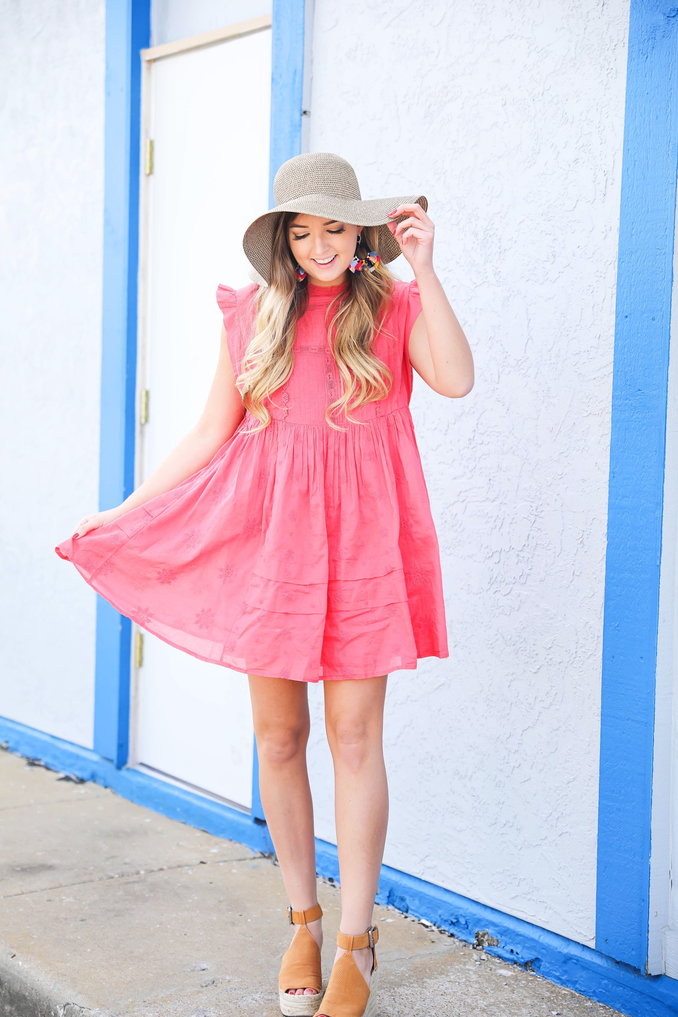 Coral babydoll dress by free people with floppy hat and bright tassel baublebar earrings! I love this outfit, it gives off Caribbean vibes because it is such a bright outfit! Details on fashion blog daily dose of charm by lauren lindmark