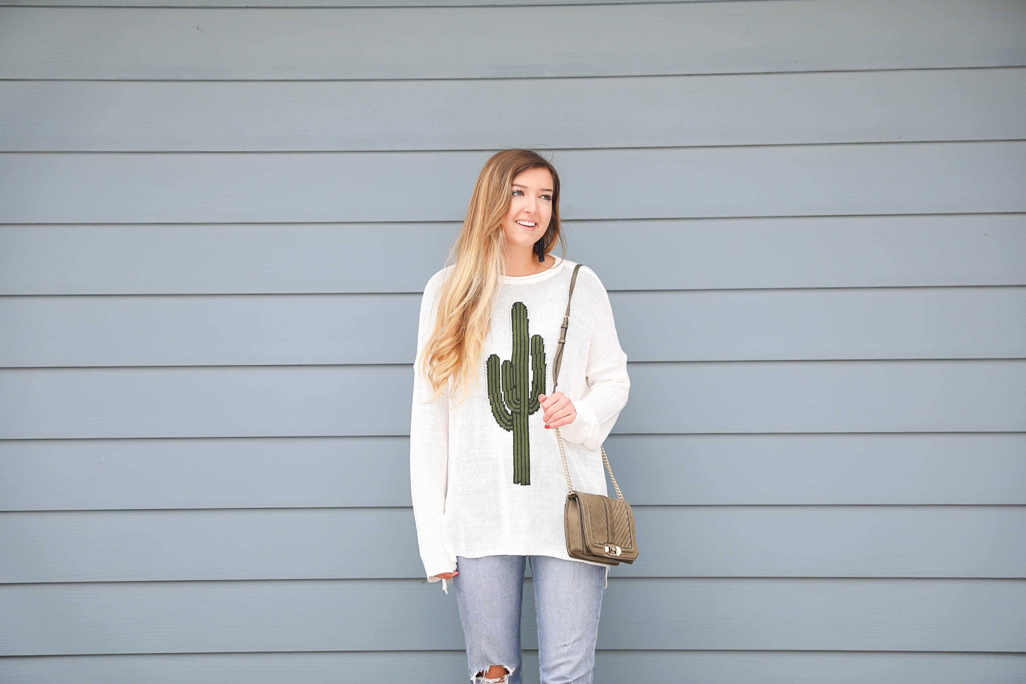 Super cute cactus sweater for spring and summer! This sweater is by Show Me Your Mumu. I love their spring cactus line, but this cactus sweater is my favorite! I paired it with booties, a black belt, and a Rebecca Minkoff bag! Perfect spring outfit inspiration on fashion blog daily dose of charm by lauren lindmark