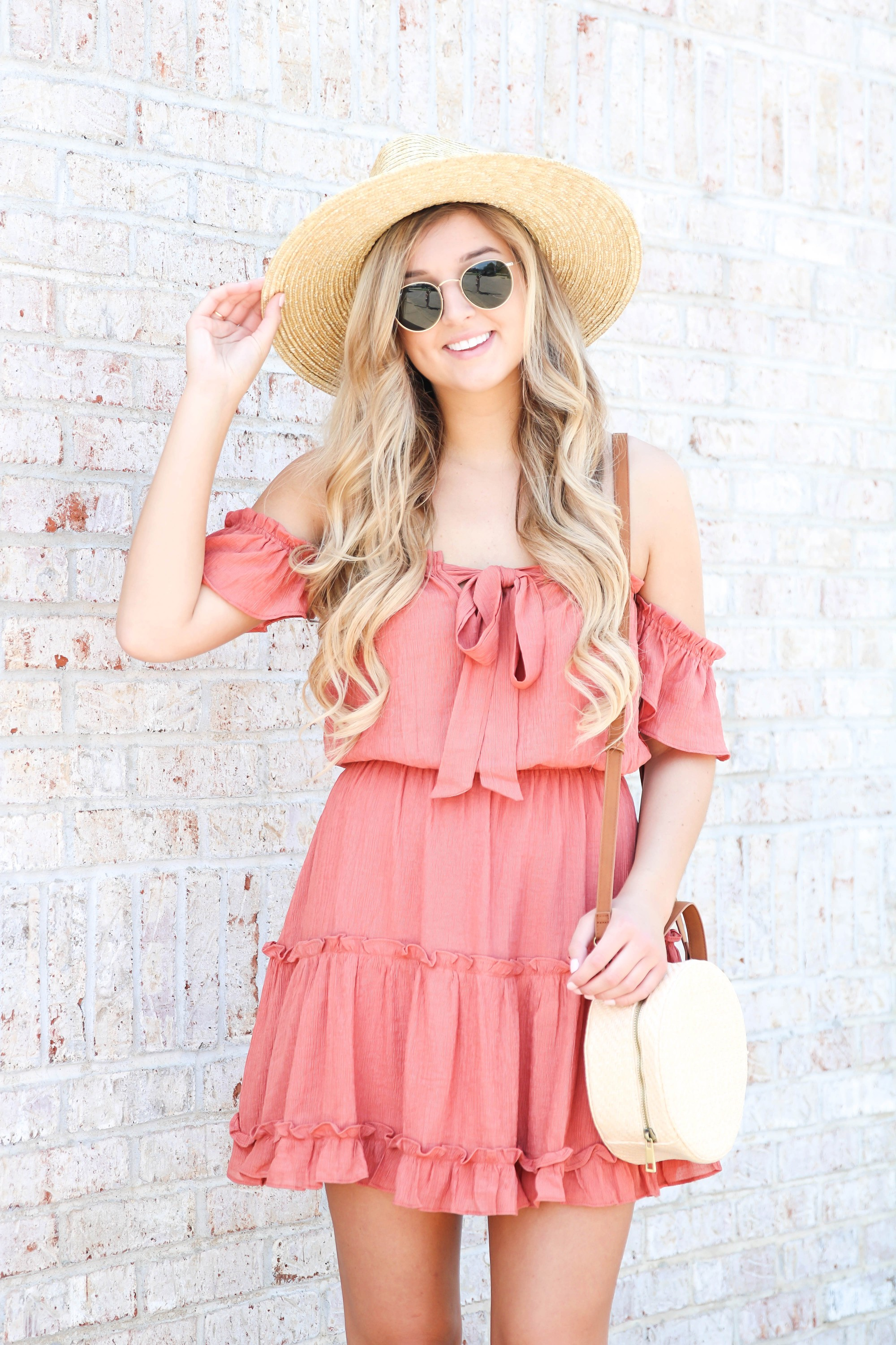 Coral tiered dress from Showpo paired with my favorite straw hat! This is the perfect summer beach hat and looks so cute with this summer sun dress! Summer fashion ideas on the blow! Details on fashion blog daily dose of charm by lauren lindmark