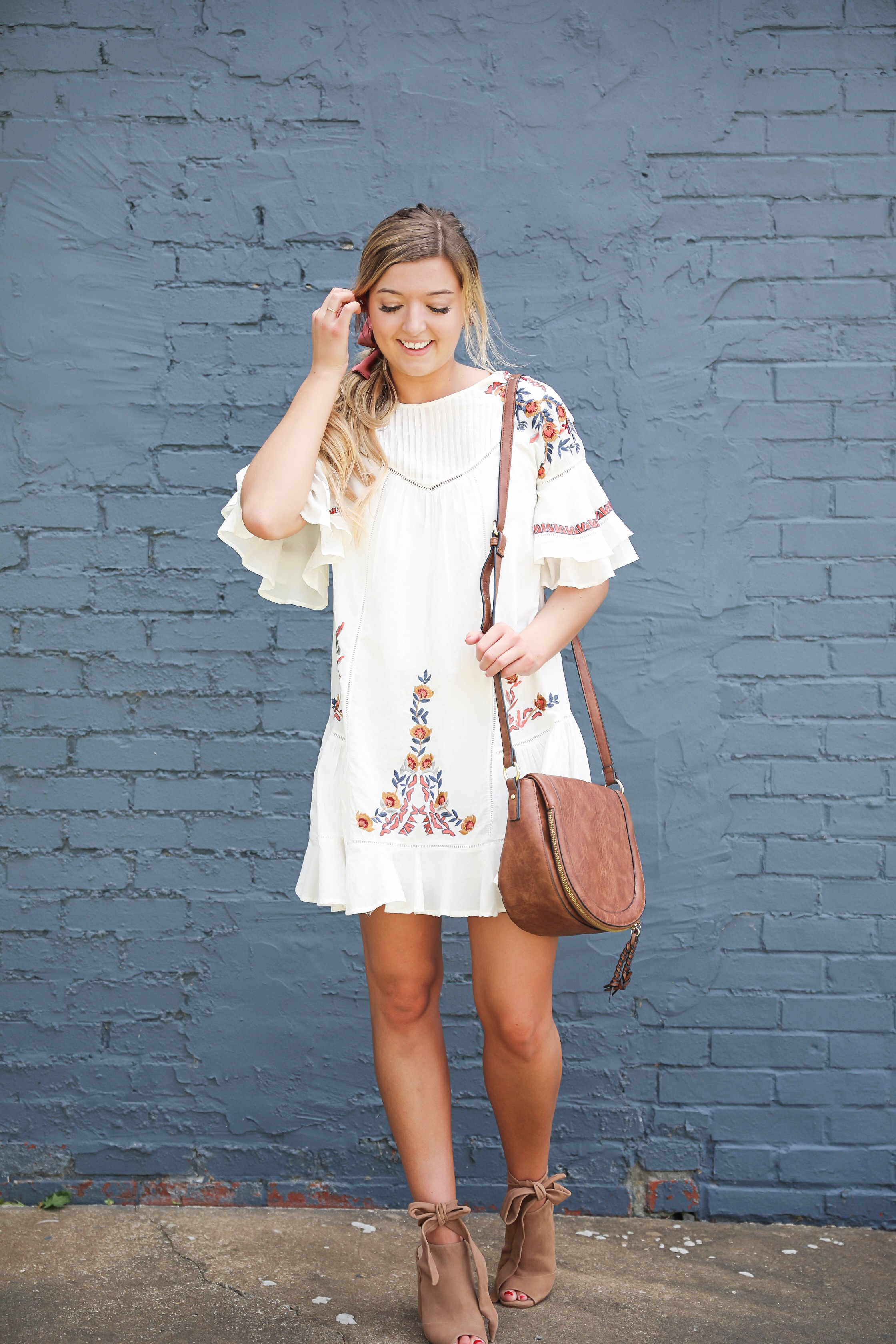 Free People embrodiered white dress for summer! I paired this adorable summer dress with a mauve hair bow and saddle bag by sole society! I love my hair in a ponytail with a bow, hair scarves are so in right now! Details on fashion blog by daily dose of charm by lauren lindmark