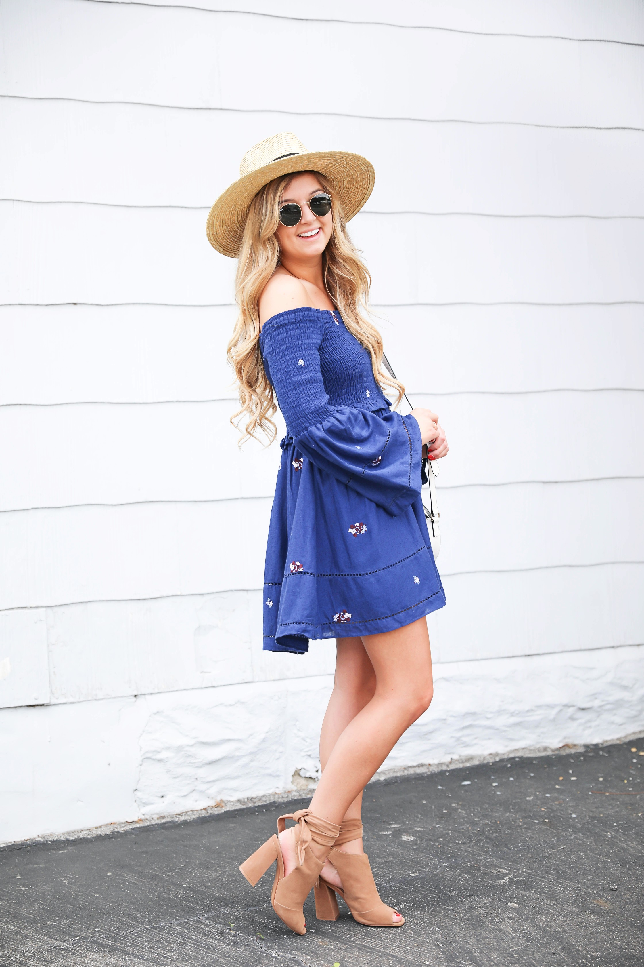 Navy free people off the shoulder embroidered dress! Love this summer fashion look! This summer dress will be perfect for days on the town or nights out! Details on fashion blog daily dose of charm by fashion blogger lauren lindmark