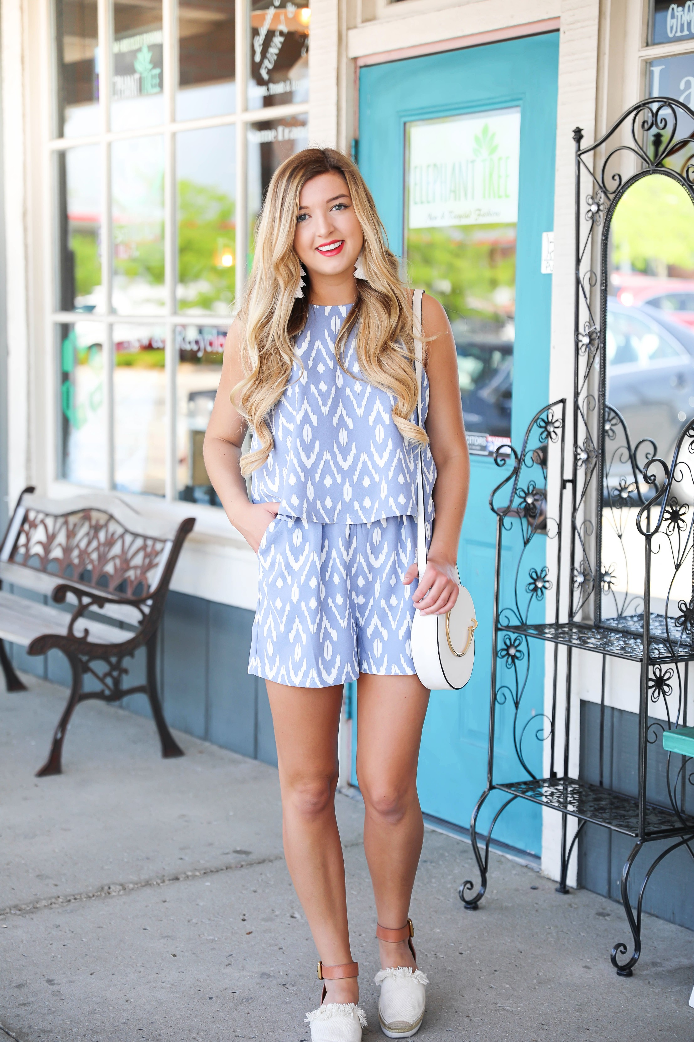 Palmer Romper in periwinkle Ikat pattern! This adorable romper is from blue door boutique! It is so perfect for spring and summer and the cute Aztec pattern makes it unique! Blue romper with blonde curly hair paired with my favorite espadrilles sandals from see by chloe! Details on fashion blog daily dose of charm by lauren lindmark