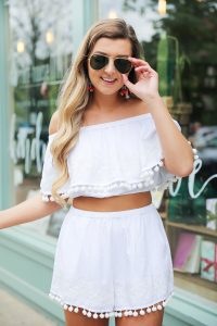 Two piece white pom pom outfit! This look is from Show Me Your Mumu! Two piece outfits are so in and this white pom pom set for spring and summer will be on repeat! Paired with colorful Sugarfix by baublebar earrings! Details on fashion blog daily dose of charm by lauren lindmark