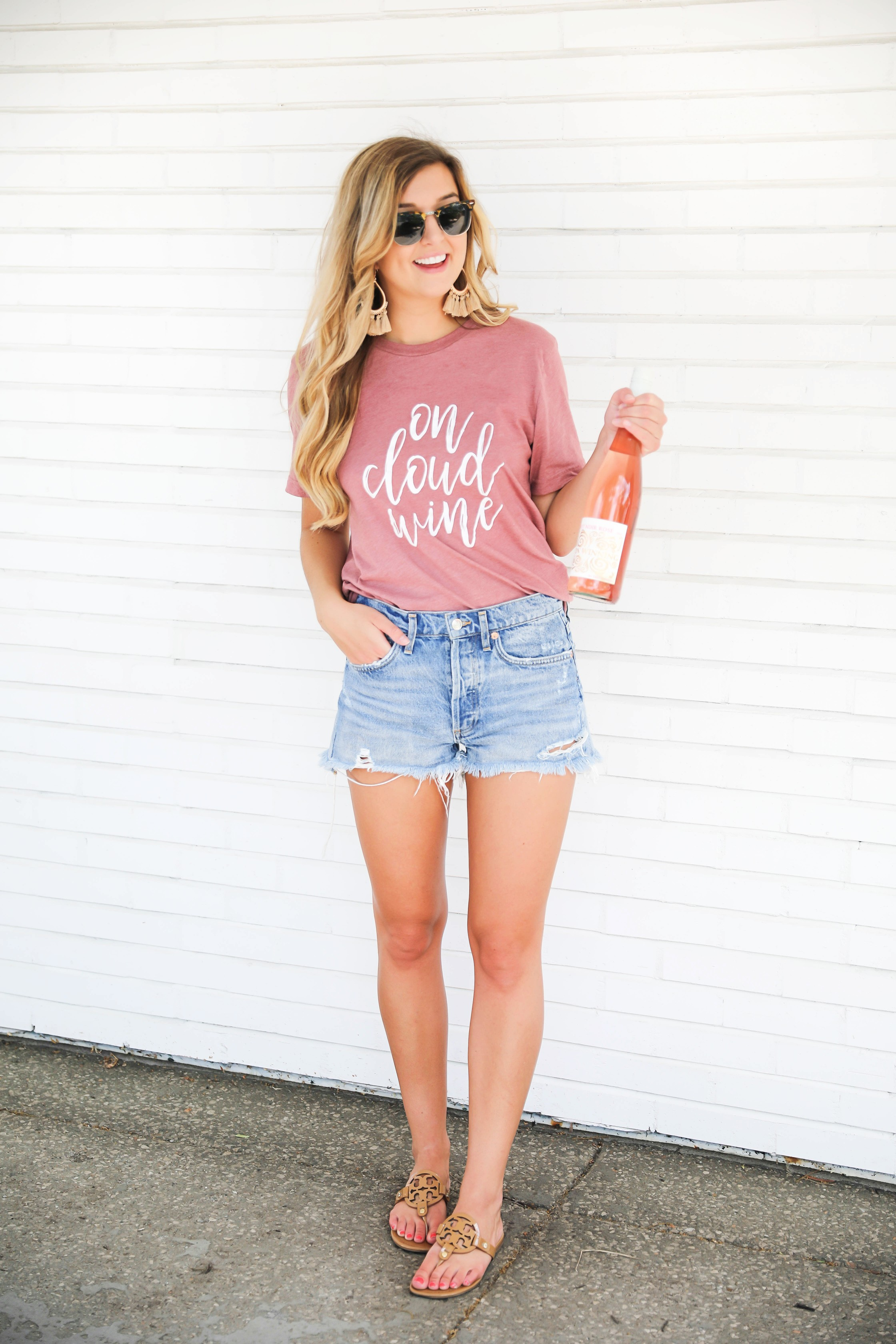 National Rosé Day 2018! I love this on cloud wine tshirt! Wine tees are my favorite! I paired it with the best ripped denim shorts in the world! Get the details on fashion blog daily dose of charm by lauren lindmark