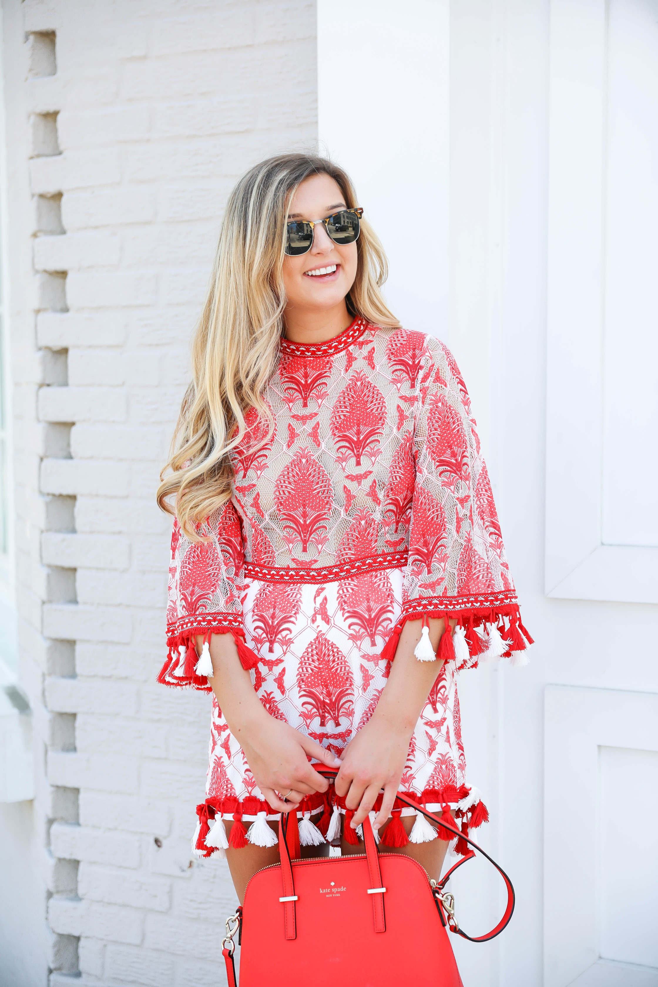 Red and white tassel lace romper from ebay! This is the perfect summer romper, I love the tassels around the sleeves and legs! How cute would this be on the beach? Kate spade red purse styled with this romper! Details on kansas city fashion blog daily dose of charm by lauren lindmark