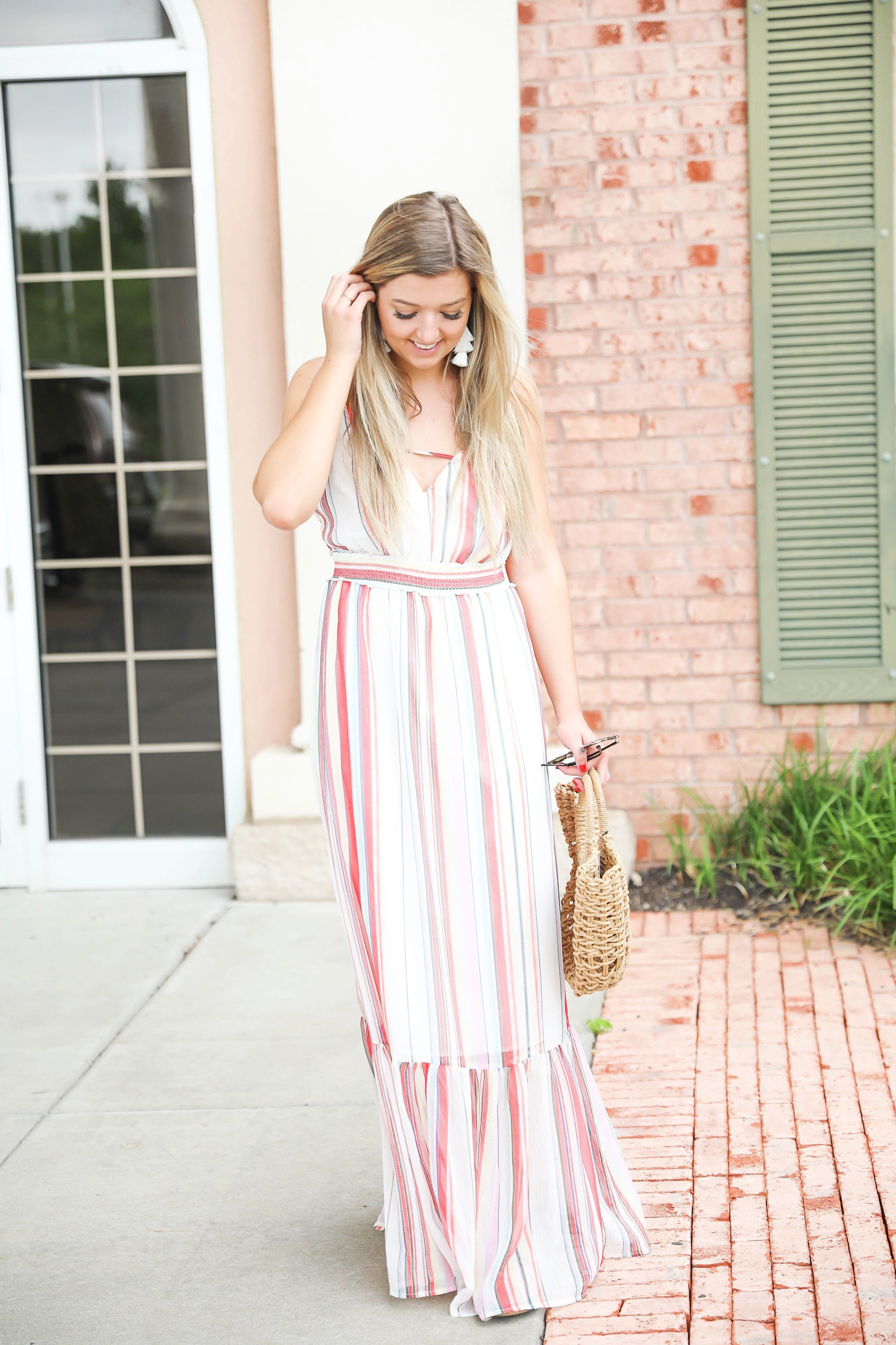 Striped summer maxi dress from revolve! Cute summer fashion and easy outfit ideas! Paired with my favorite straw bag on my blog daily dose of charm by lauren lindmark