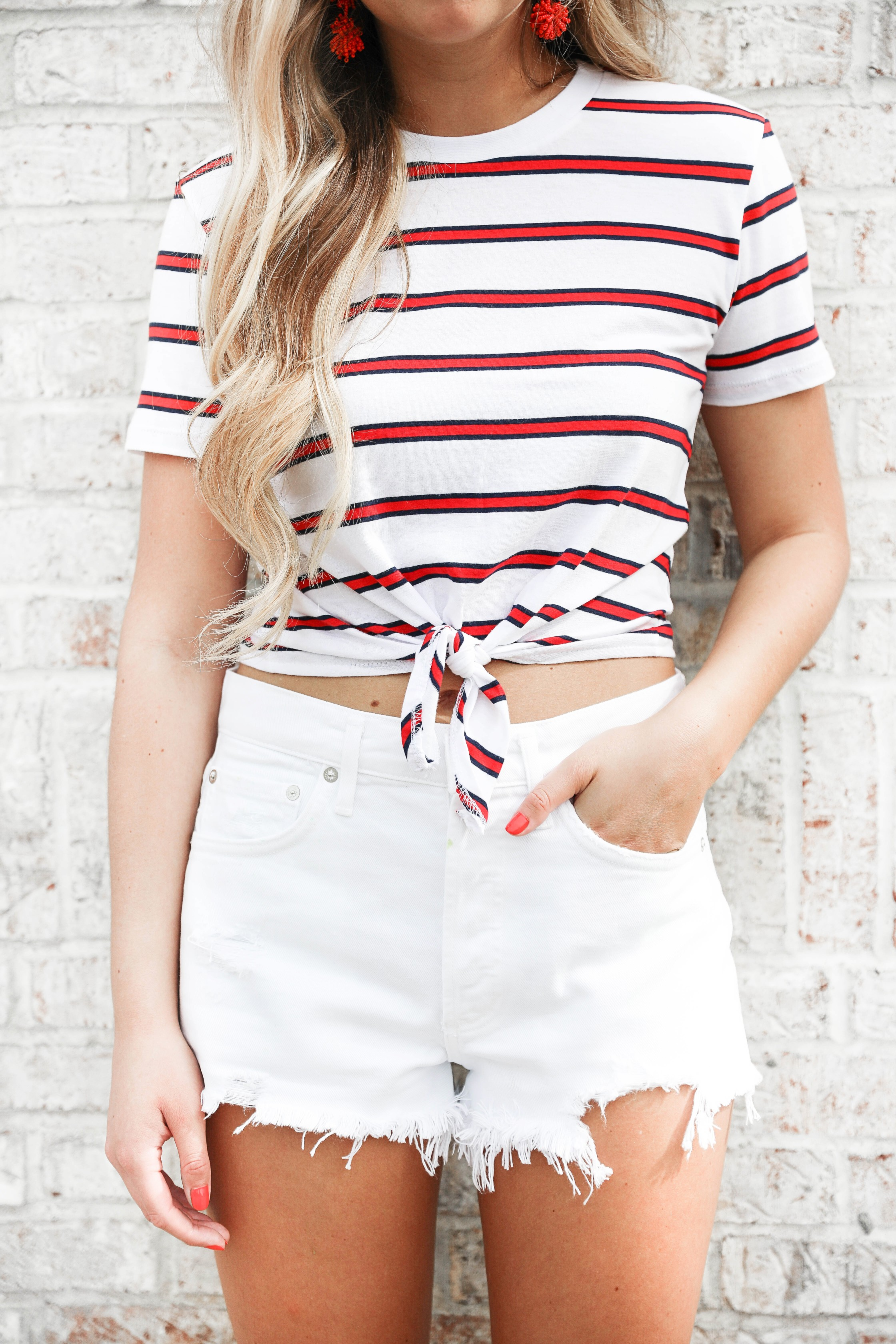 Striped tied boating top! I love tops that are tied like this, the crop is so cute with the stripes! Paired with my favorite white jean shorts that fit so well and my new red statement earrings! Cute snow cone photoshoot! Details on fashion blog daily dose of charm by lauren lindmark