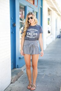 Surround yourself with tacos, not negativity. This is the cutest taco tee! I have been loving for a cute taco tshirt and this one is adorable with my striped cotton shorts! Tied shorts are so in right now! Summer fashion details on the blog daily dose of charm by lauren lindmark