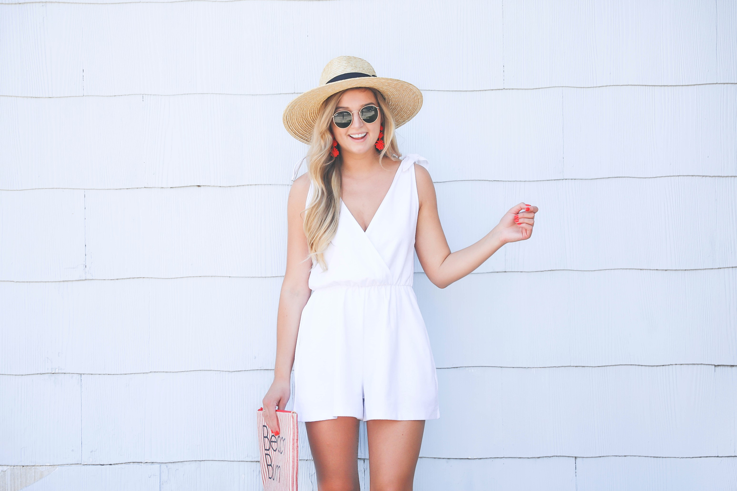 White romper for summer! This romper has a cute plunging neckline and ties on the shoulders. I love that it is linen because it won't wrinkle as easily! This romper and red statement earrings will be perfect for the Fourth of July! Paired with my cute nude heels and wide brimmed hat fashion! Details on fashion blog daily dose of charm by lauren lindmark