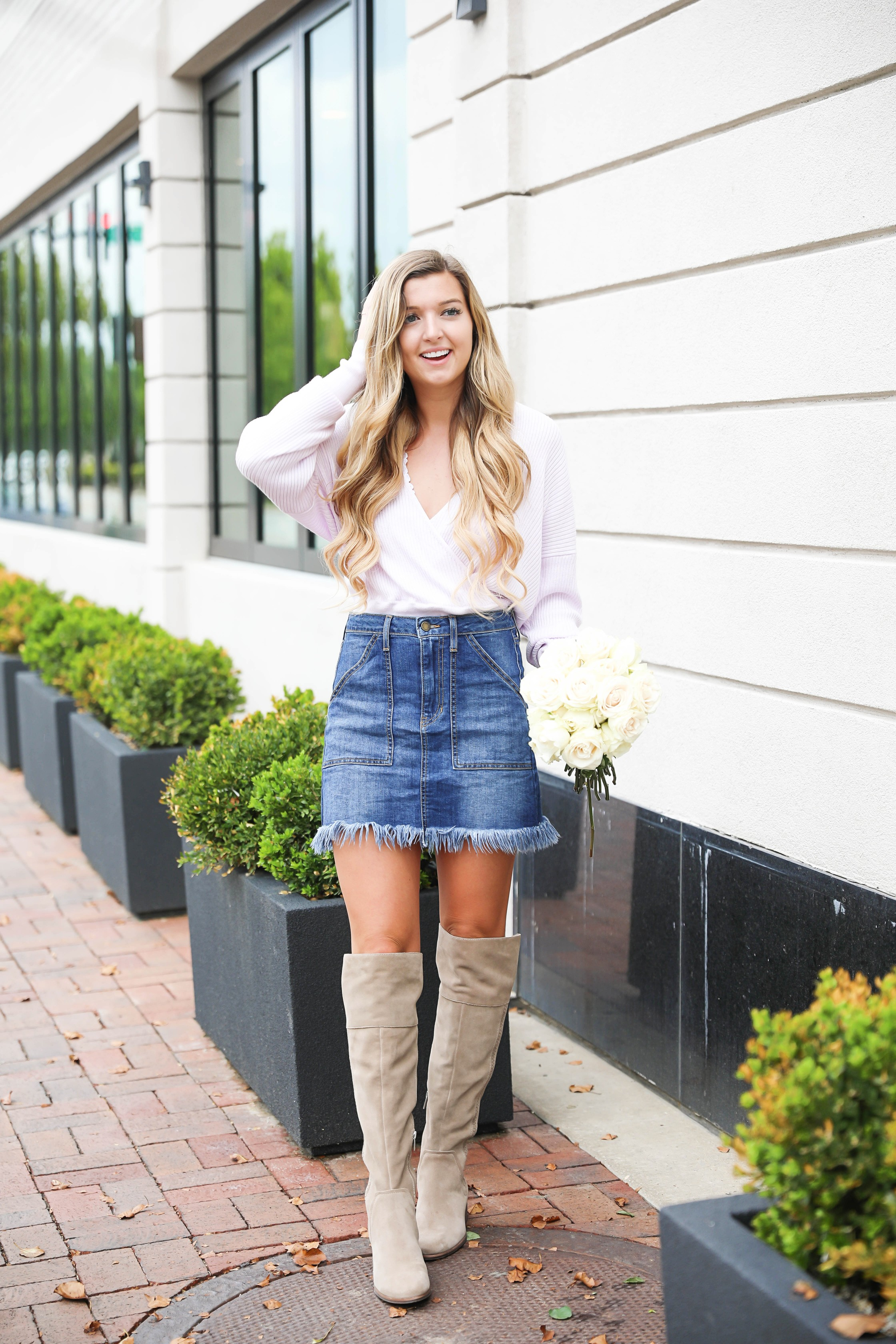 Lavender deep-v sweater from the Nordstrom Anniversary Sale! Paired with a cute white lace bralette and frayed denim skirt! I finished the look with my new over the knee suede boots! All from the nordstrom anniversary sale 2018! Details on fashion blog daily dose of charm by Lauren Lindmark