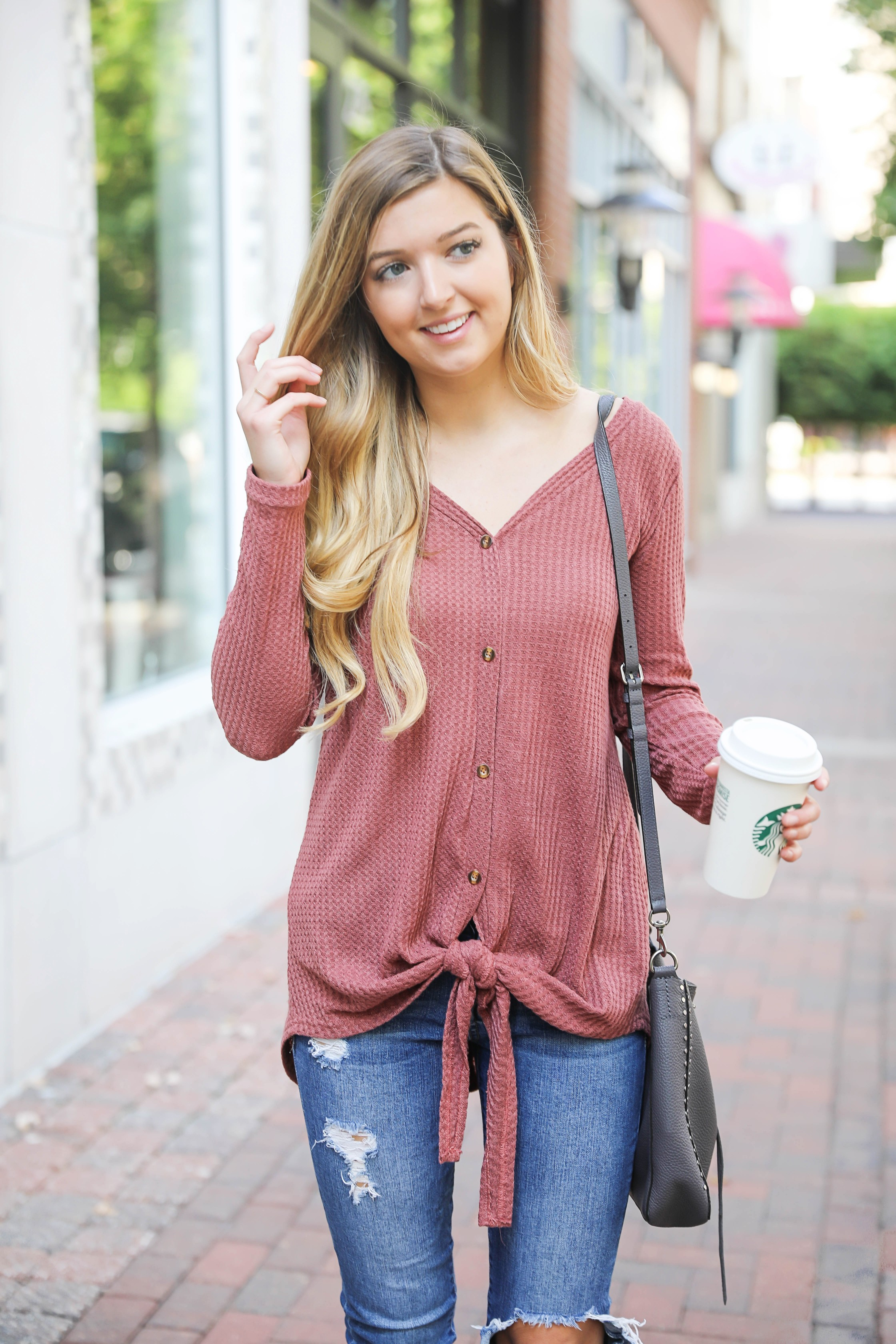 Burgundy waffle top! These waffle tops are all the rage, I love when they are tied on the end! It comes in a ton of cute fall colors. I paired mine with ripped denim jeans and this cute Rebecca Minkoff purse! Such a cute fall outfit for back to school! Details on fashion blog daily dose of charm by lauren lindmark