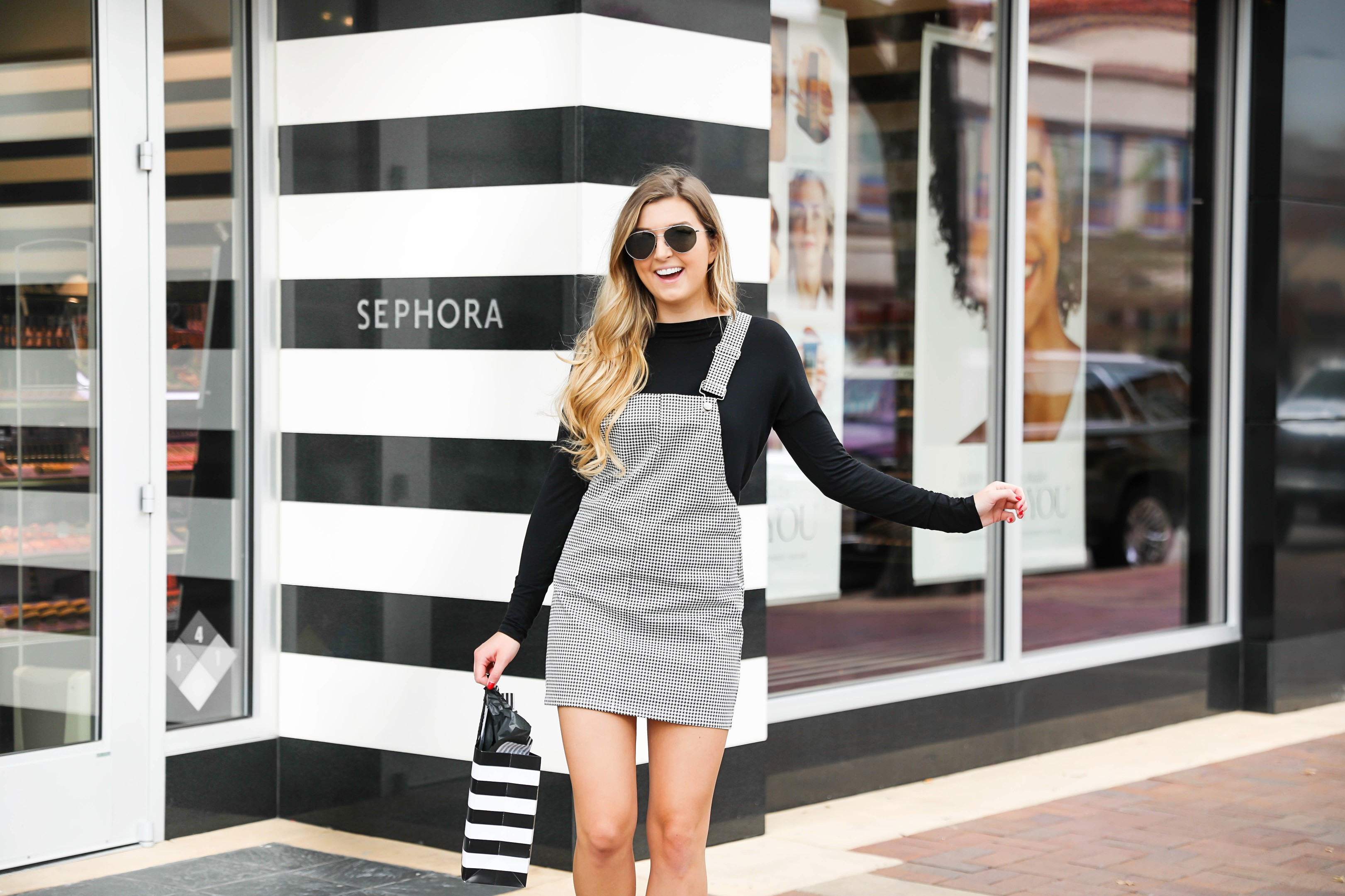 Sephora sale favorites that I use everyday! Check out all the best things to buy in the 2018 Sephora sale plus see my wishlist! The cutest fall outfit is also featured in this post so get details on this black and white checkered overall dress on fashion blog daily dose of charm by lauren lindmark